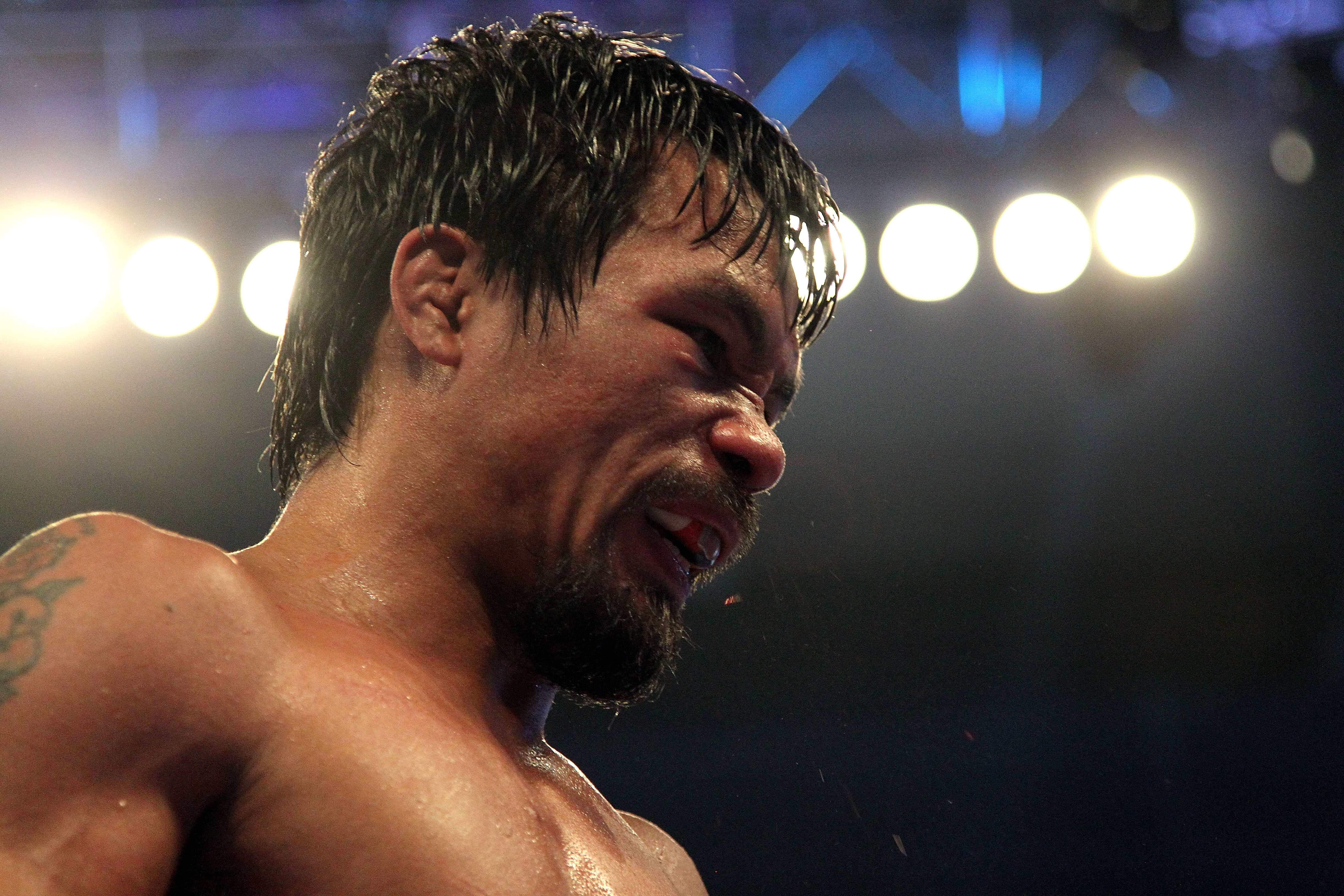 ARLINGTON, TX - MARCH 13:  Manny Pacquiao of the Philippines looks on in the ring against Joshua Clottey of Ghana during the WBO welterweight title fight at Cowboys Stadium on March 13, 2010 in Arlington, Texas. Pacquiao defeated Clottey by unanimous deci