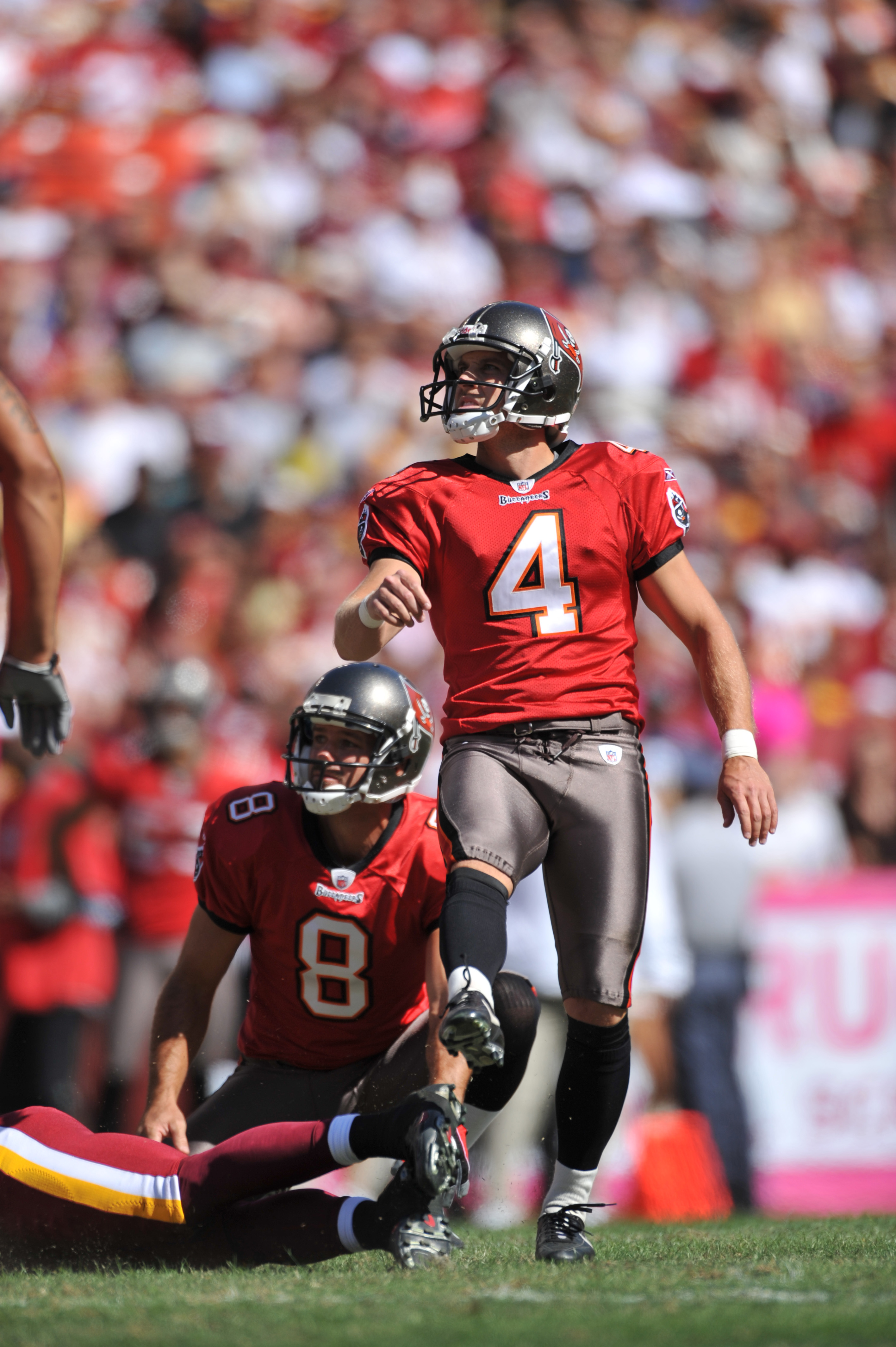 LANDOVER, MD - OCTOBER 4:  Mike Nugent #4 of the Tampa Bay Buccaneers watches his missed field goal against the Washington Redskins at FedExField on October 4, 2009 in Landover, Maryland. The Redskins defeated the Buccaneers 16-13. (Photo by Larry French/