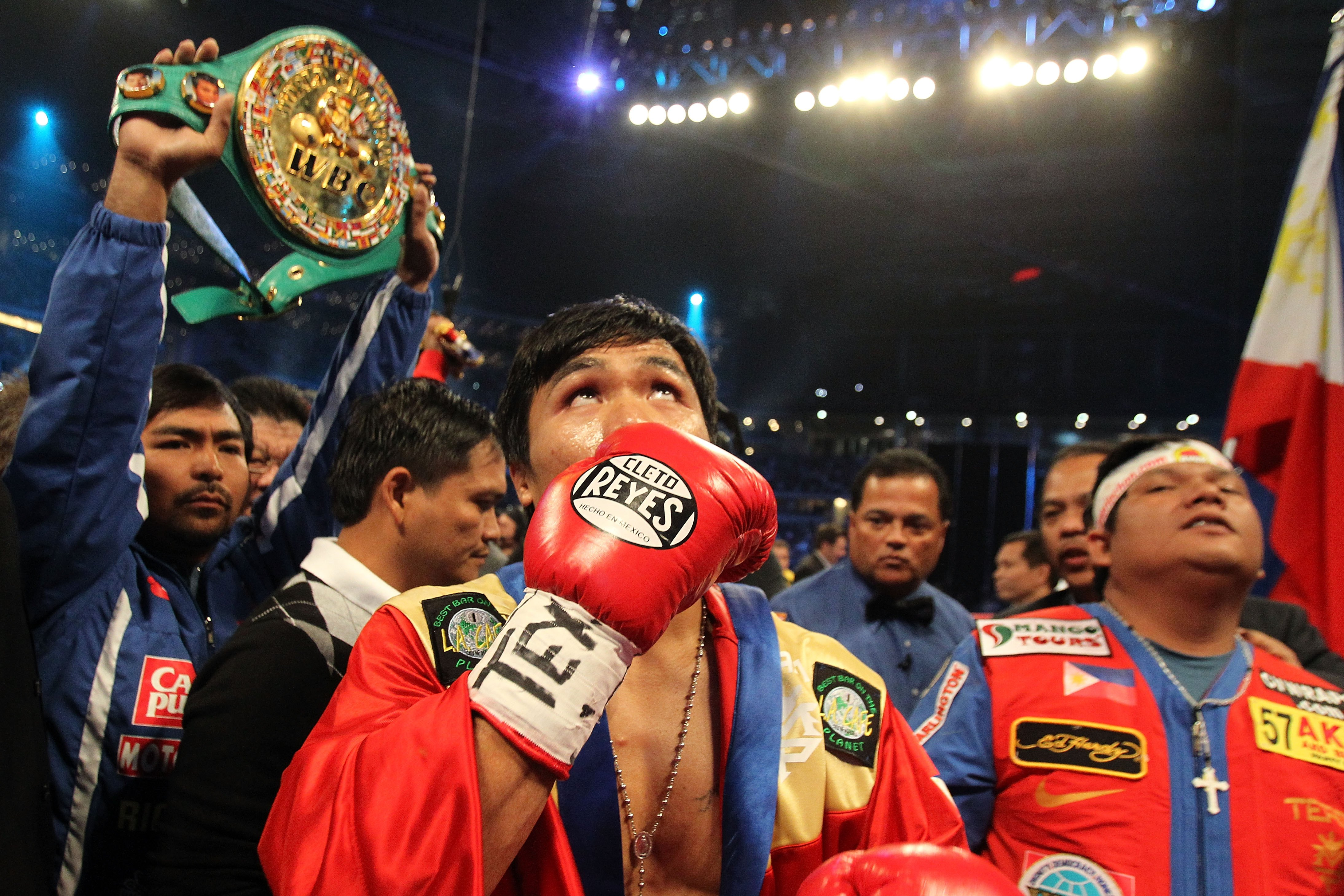ARLINGTON, TX - MARCH 13:  Manny Pacquiao of the Philippines in the ring before taking on Joshua Clottey of Ghana during the WBO welterweight title fight at Cowboys Stadium on March 13, 2010 in Arlington, Texas.  (Photo by Jed Jacobsohn/Getty Images)