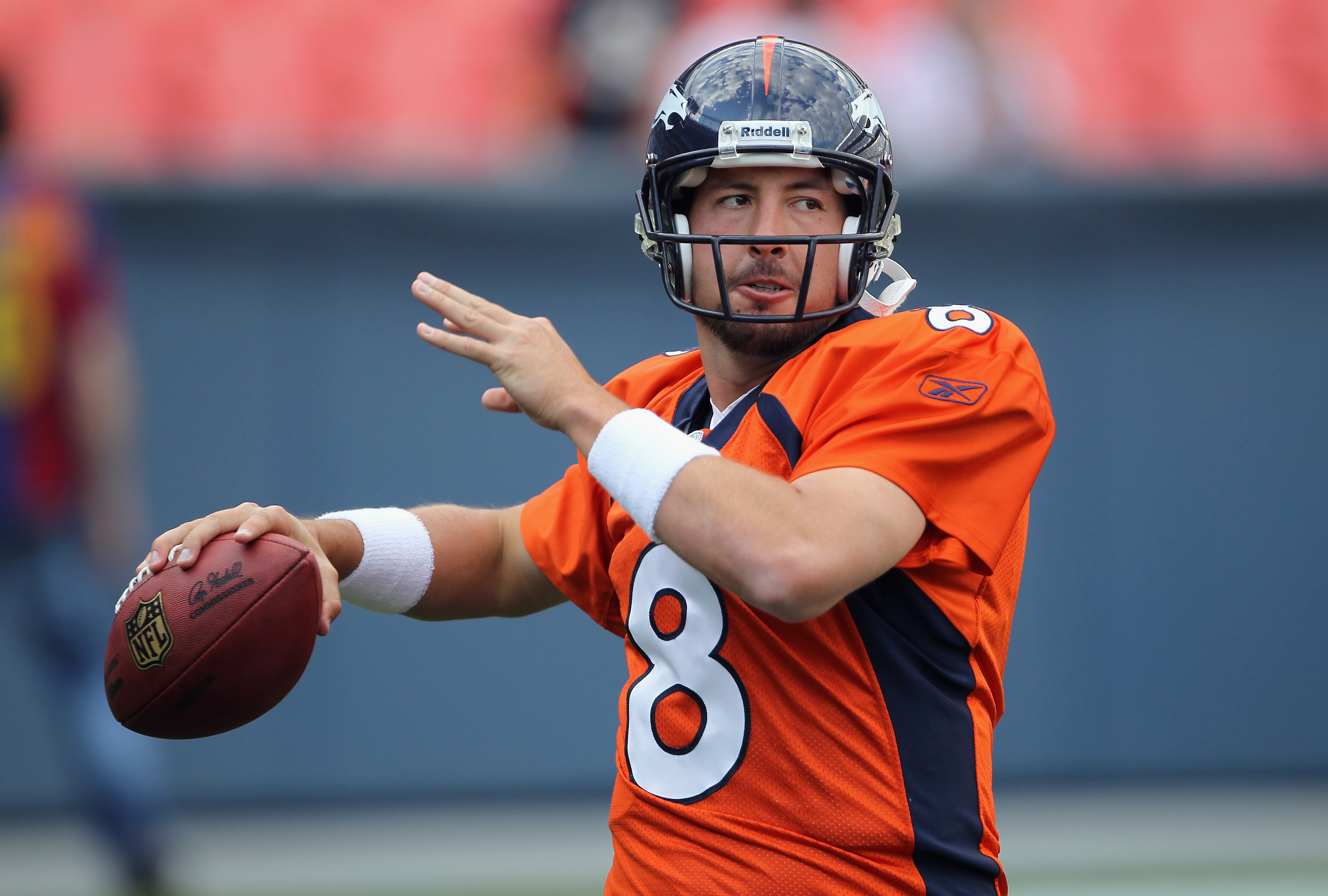 DENVER - AUGUST 21:  Quarterback Kyle Orton #8 of the Denver Broncos warms up prior to facing the Detroit Lions during preseason NFL action at INVESCO Field at Mile High on August 21, 2010 in Denver, Colorado. The Lions defeated the Broncos 25-20.  (Photo