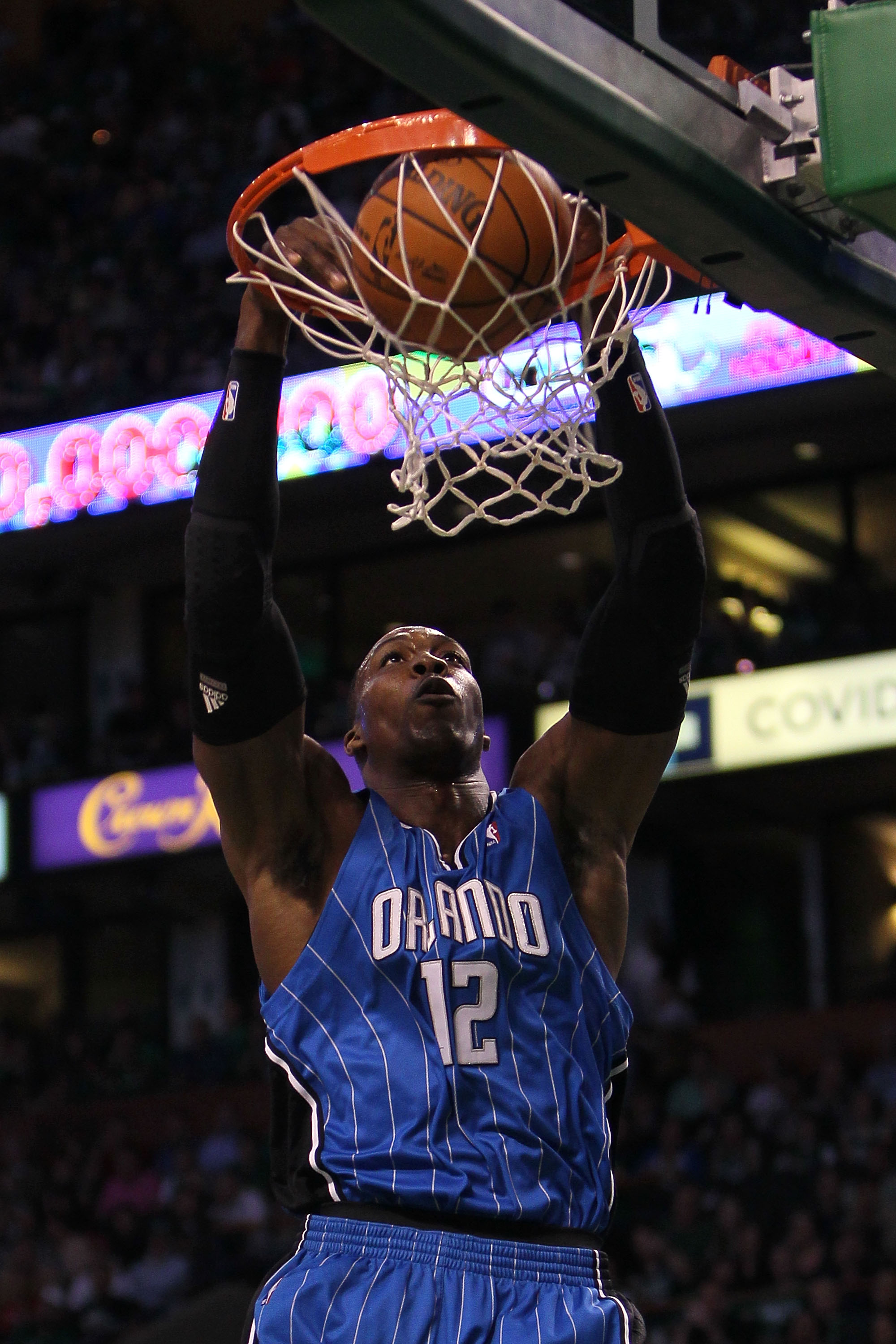 BOSTON - MAY 28:  Dwight Howard #12 of the Orlando Magic  dunks against the Boston Celtics in Game Six of the Eastern Conference Finals during the 2010 NBA Playoffs at TD Garden on May 28, 2010 in Boston, Massachusetts.  NOTE TO USER: User expressly ackno