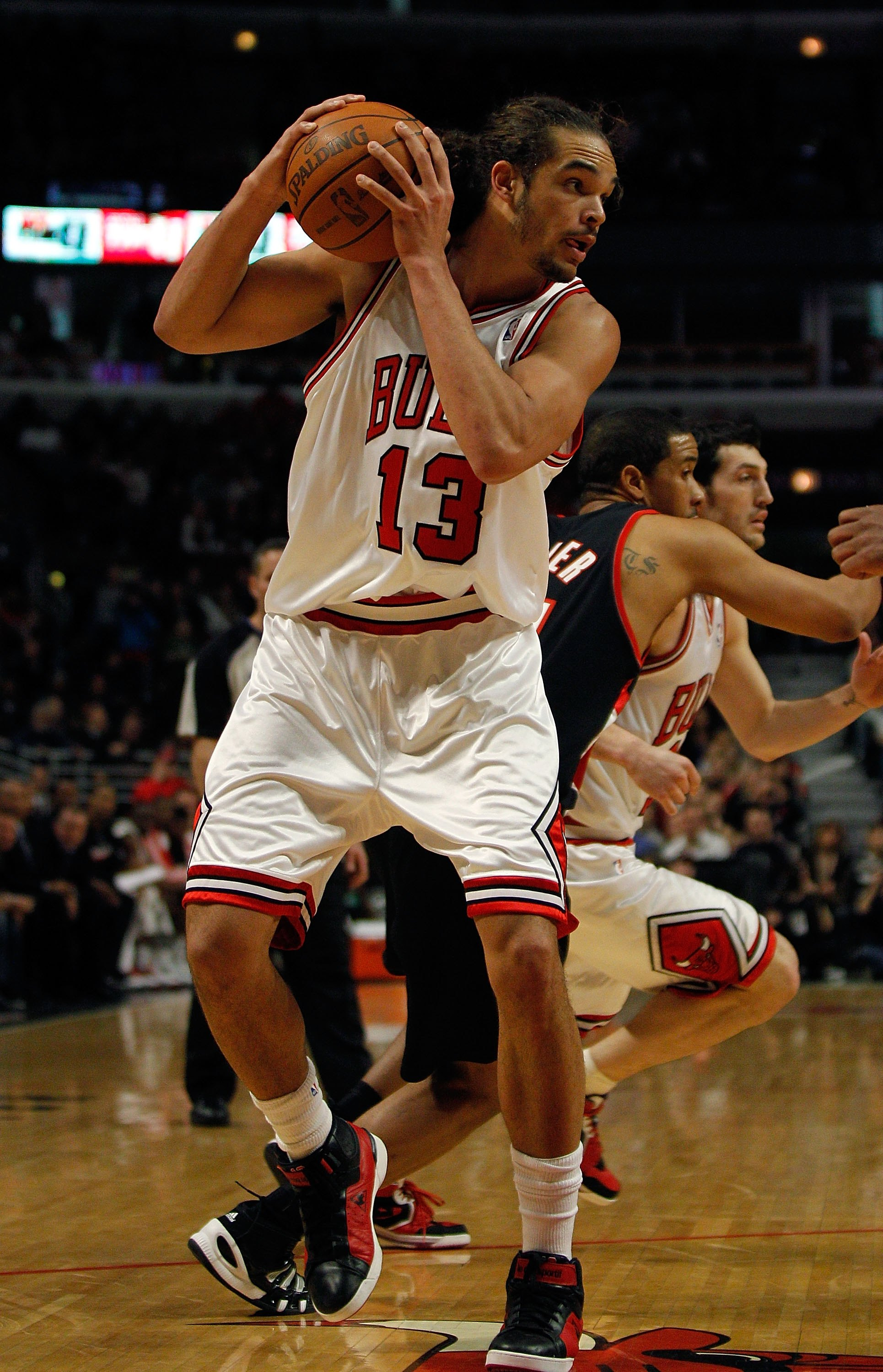 CHICAGO - FEBRUARY 26: Joakim Noah #13 of the Chicago Bulls looks to pass against the Portland Trail Blazers at the United Center on February 26, 2010 in Chicago, Illinois. The Bulls defeated the Trail Blazers 115-111 in overtime. NOTE TO USER: User expre