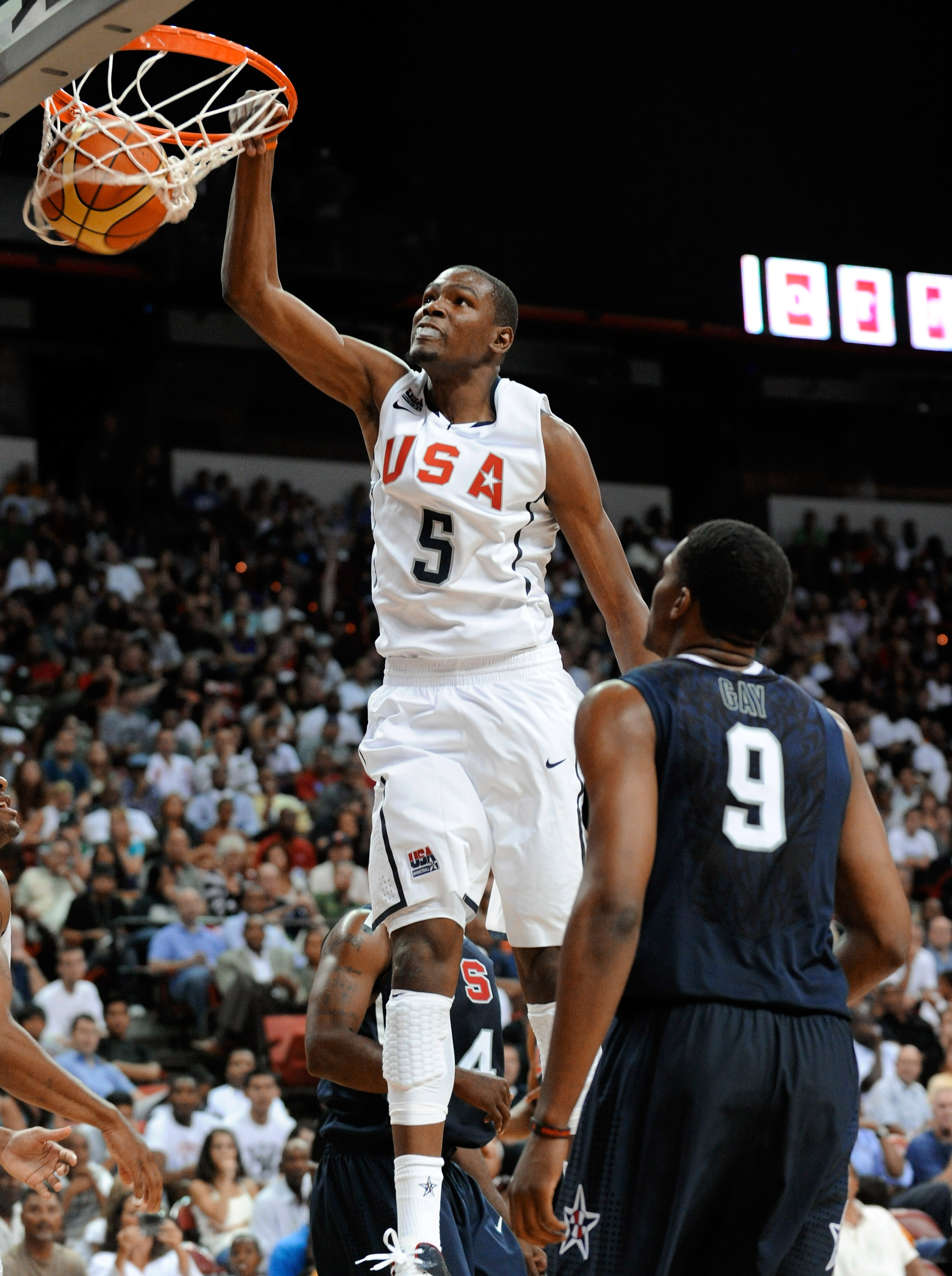 LAS VEGAS - JULY 24:  Kevin Durant #5 of the 2010 USA Basketball Men's National Team dunks over Rudy Gay #9 of the 2010 USA Basketball Men's National Team during a USA Basketball showcase at the Thomas & Mack Center on July 24, 2010 in Las Vegas, Nevada.