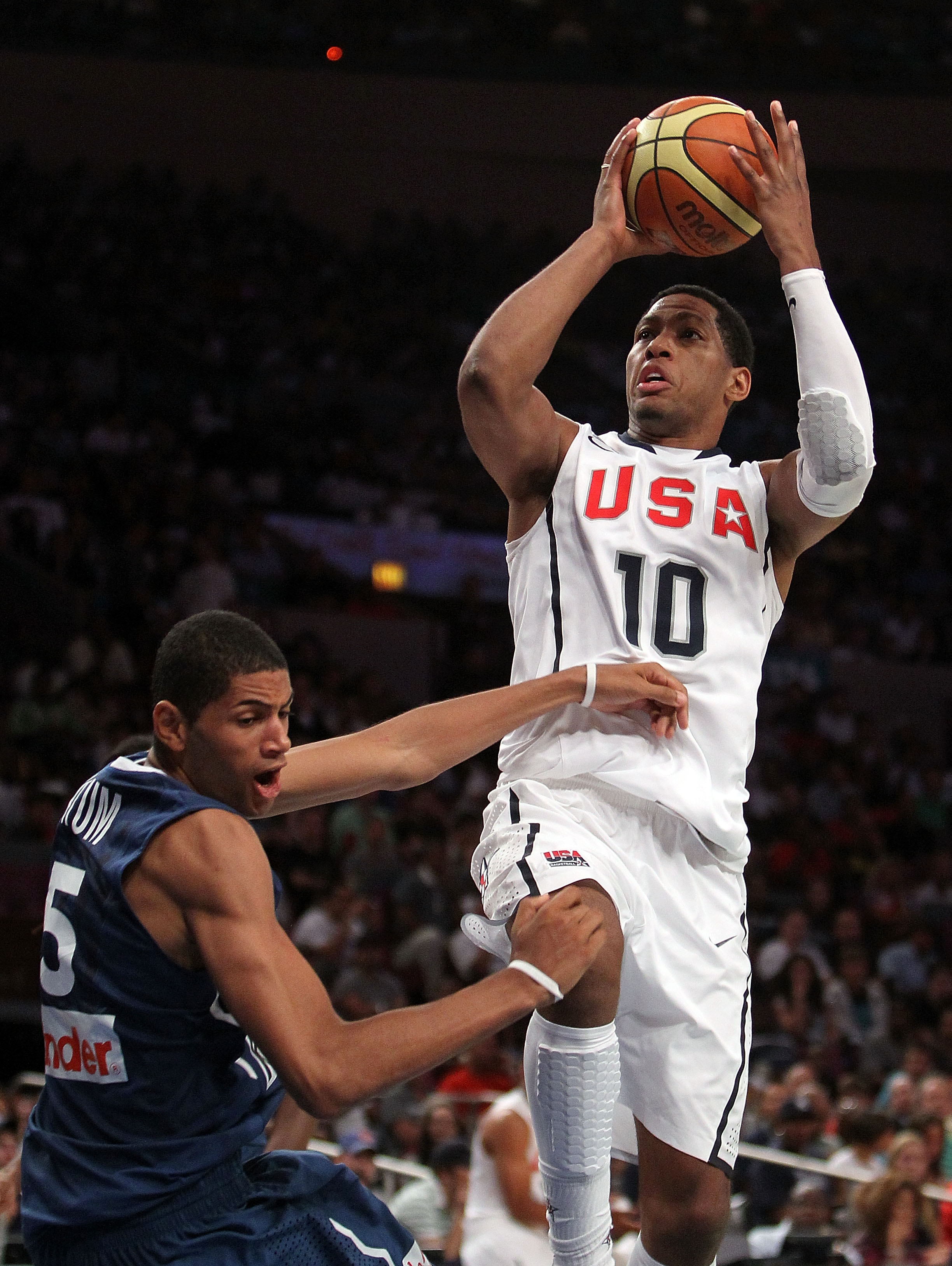 NEW YORK - AUGUST 15: Danny Granger #10 of the United States shoots over Nicholas Batum #5 of France during their exhibition game as part of the World Basketball Festival at Madison Square Garden on August 15, 2010 in New York City.  (Photo by Nick Laham/