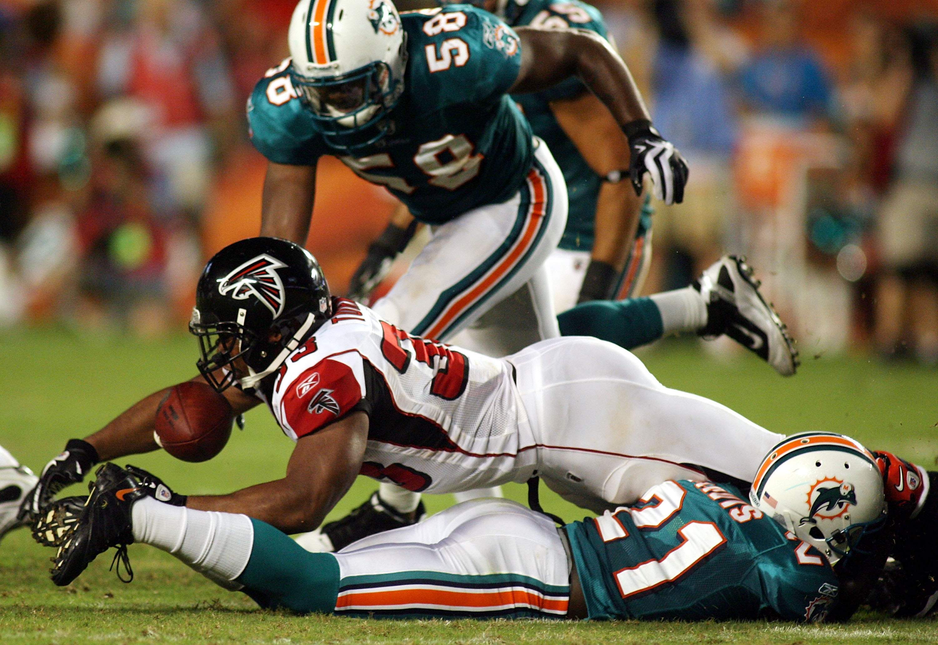 MIAMI - AUGUST 27: Running back Michael Turner #33 of the Atlanta Falcons fumbles against the Miami Dolphins during their preseason game at Sun Life Stadium on August 27, 2010 in Miami, Florida.  (Photo by Marc Serota/Getty Images)