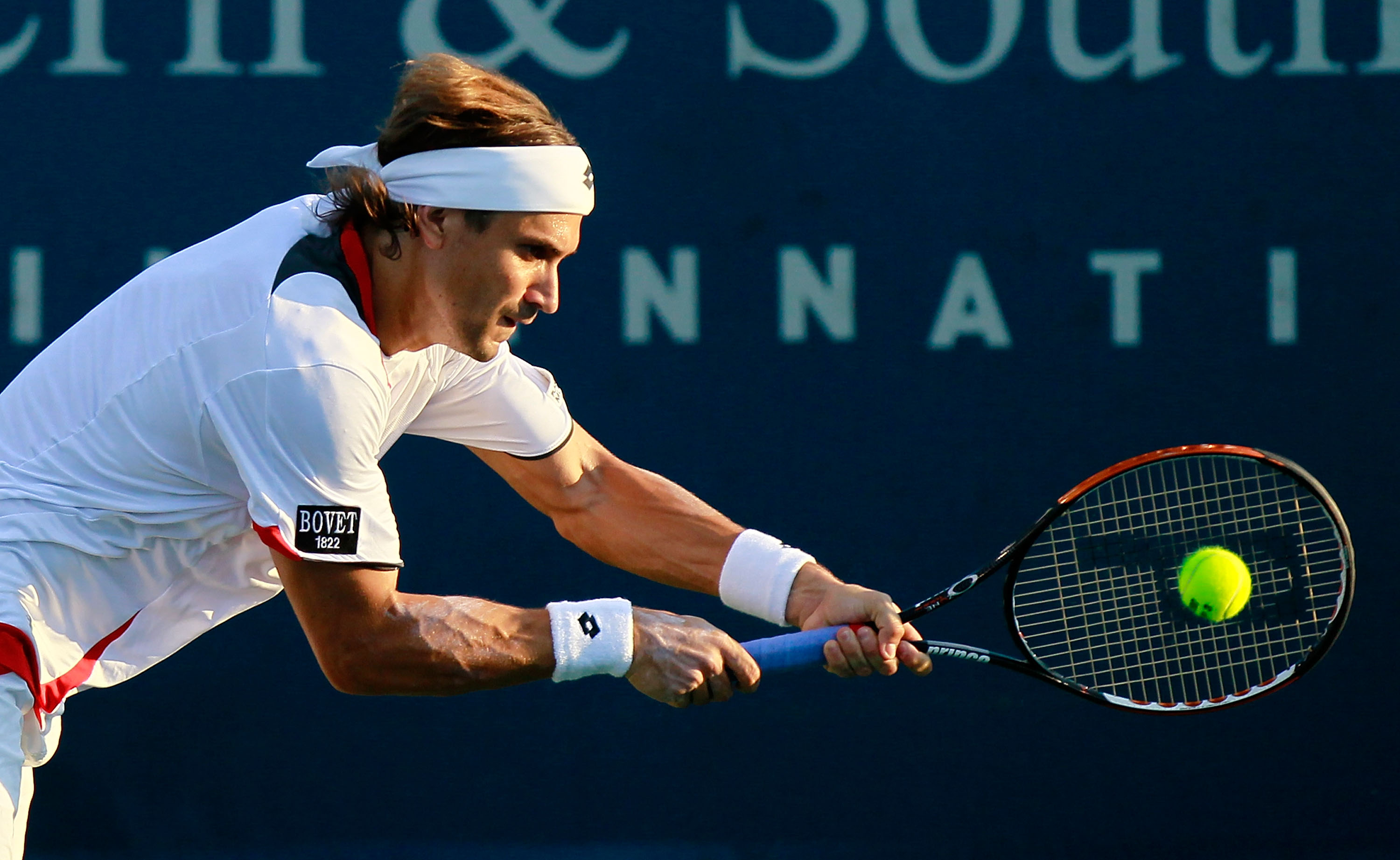 CINCINNATI - AUGUST 19:  David Ferrer of Spain returns a backhand to Nikolay Davydenko of Russia during Day 4 of the Western & Southern Financial Group Masters at the Lindner Family Tennis Center on August 19, 2010 in Cincinnati, Ohio.  (Photo by Kevin C.
