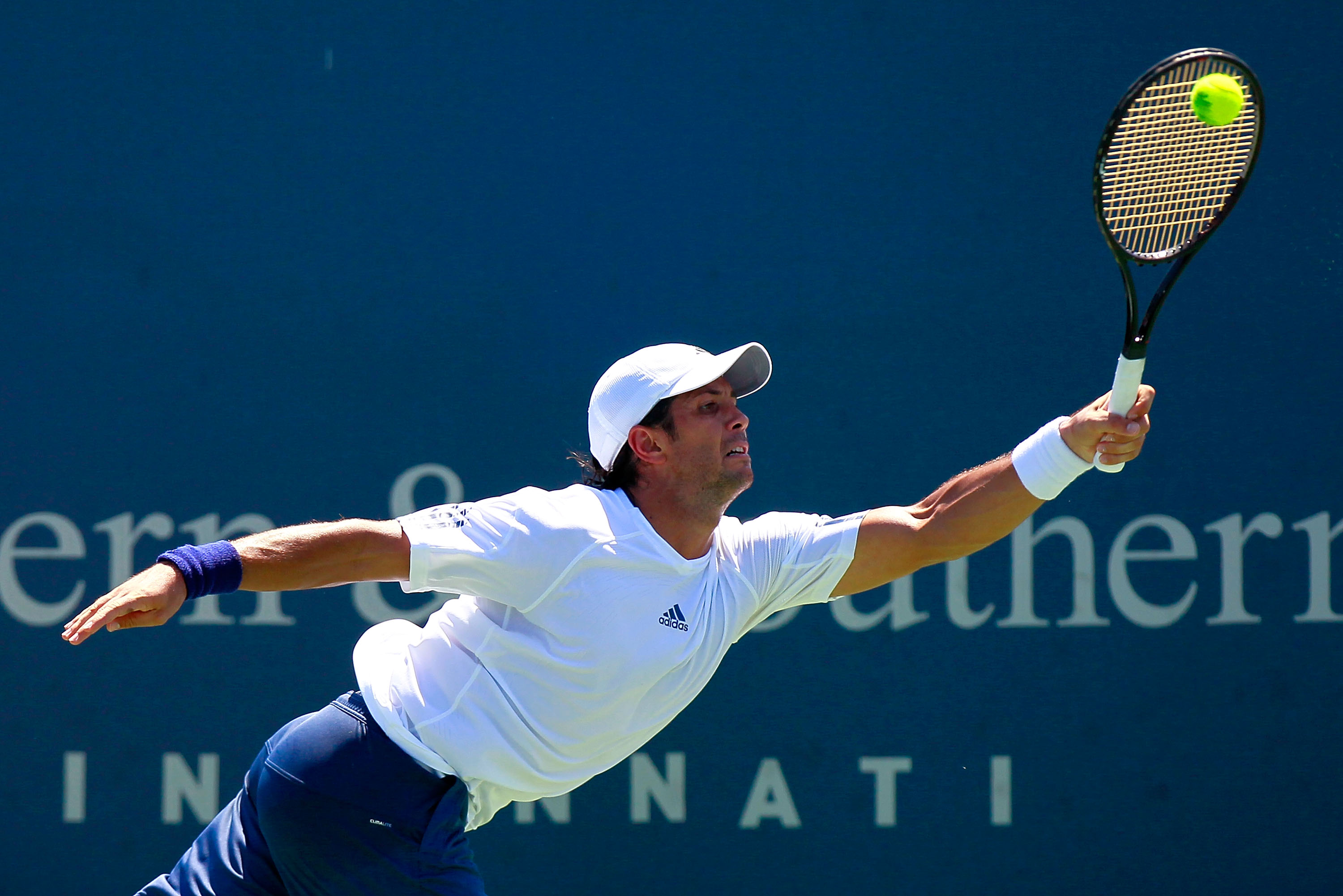 CINCINNATI - AUGUST 18:  Fernando Verdasco of Spain stretches to return a forehand to Mardy Fish during Day 3 of the Western & Southern Financial Group Masters at the Lindner Family Tennis Center on August 18, 2010 in Cincinnati, Ohio.  (Photo by Kevin C.