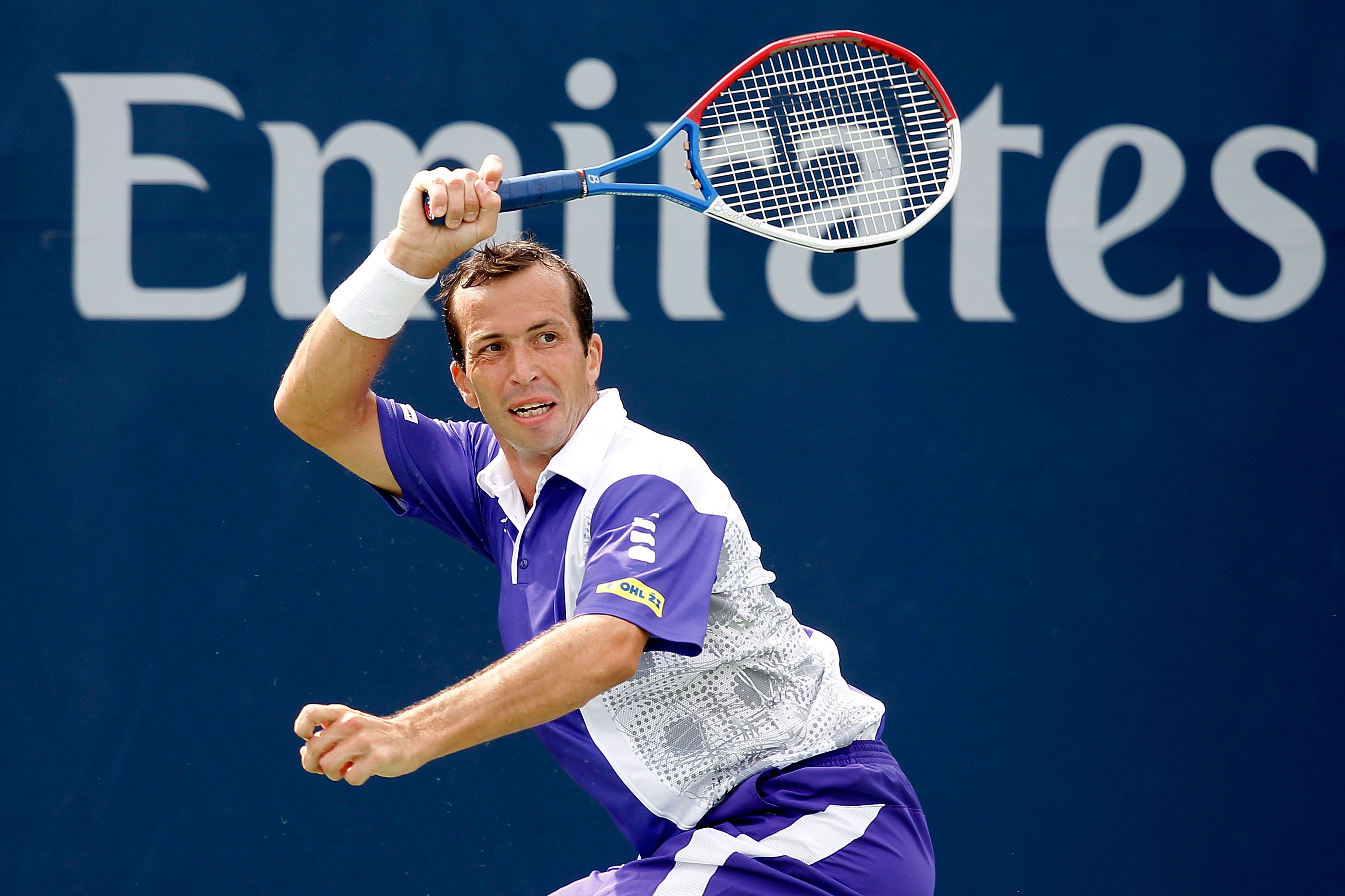 TORONTO, ON - AUGUST 10: Radek Stepanek of the Czech Republic returns a shot to Fabio Fognini of Italy during the Rogers Cup at the Rexall Centre on August 10, 2010 in Toronto, Canada.  (Photo by Matthew Stockman/Getty Images)