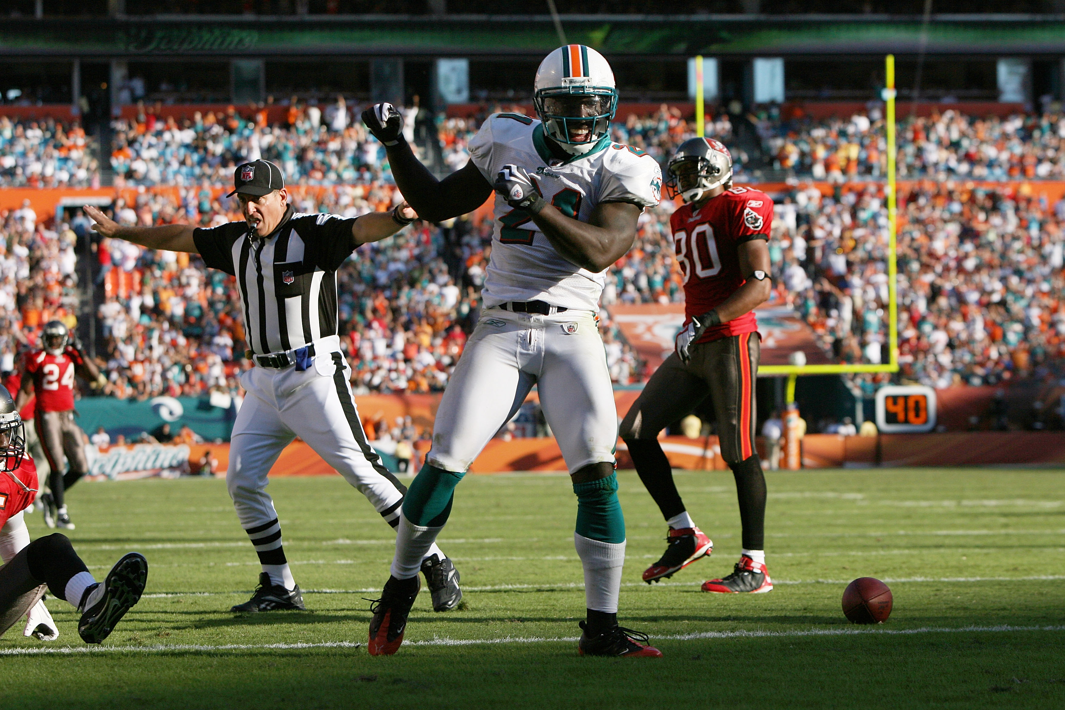 MIAMI GARDENS, FL - NOVEMBER 15:   Cornerback Vontae Davis #21 of the Miami Dolphins celebrates after breaking up a pass intended for wide receiver Maurice Stovall #85 of the Tampa Bay Buccaneers at Land Shark Stadium on November 15, 2009 in Miami Gardens