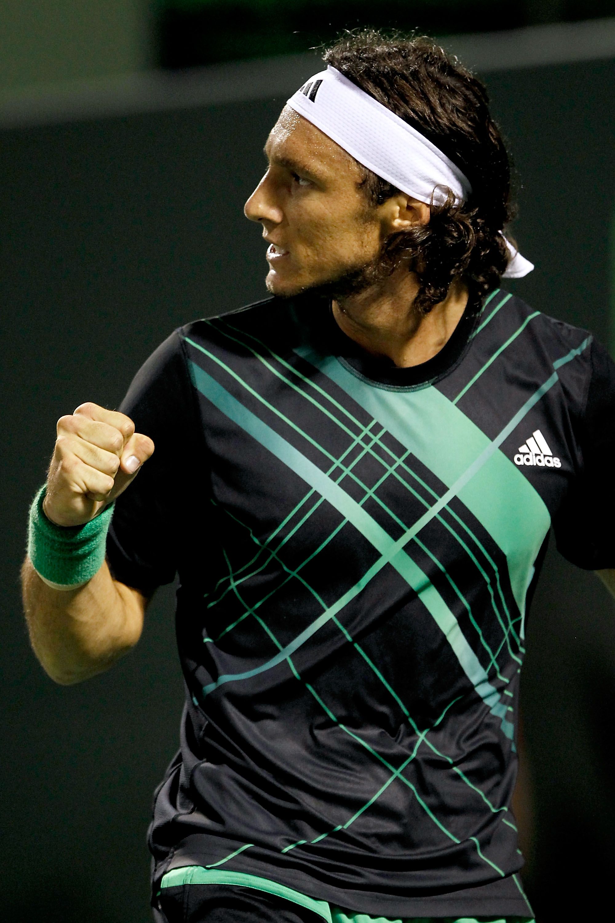 KEY BISCAYNE, FL - MARCH 29:  Juan Monaco of Argentina celebrates breaking Fernando Gonzalez of Chile in the first set during day seven of the 2010 Sony Ericsson Open at Crandon Park Tennis Center on March 29, 2010 in Key Biscayne, Florida.  (Photo by Mat