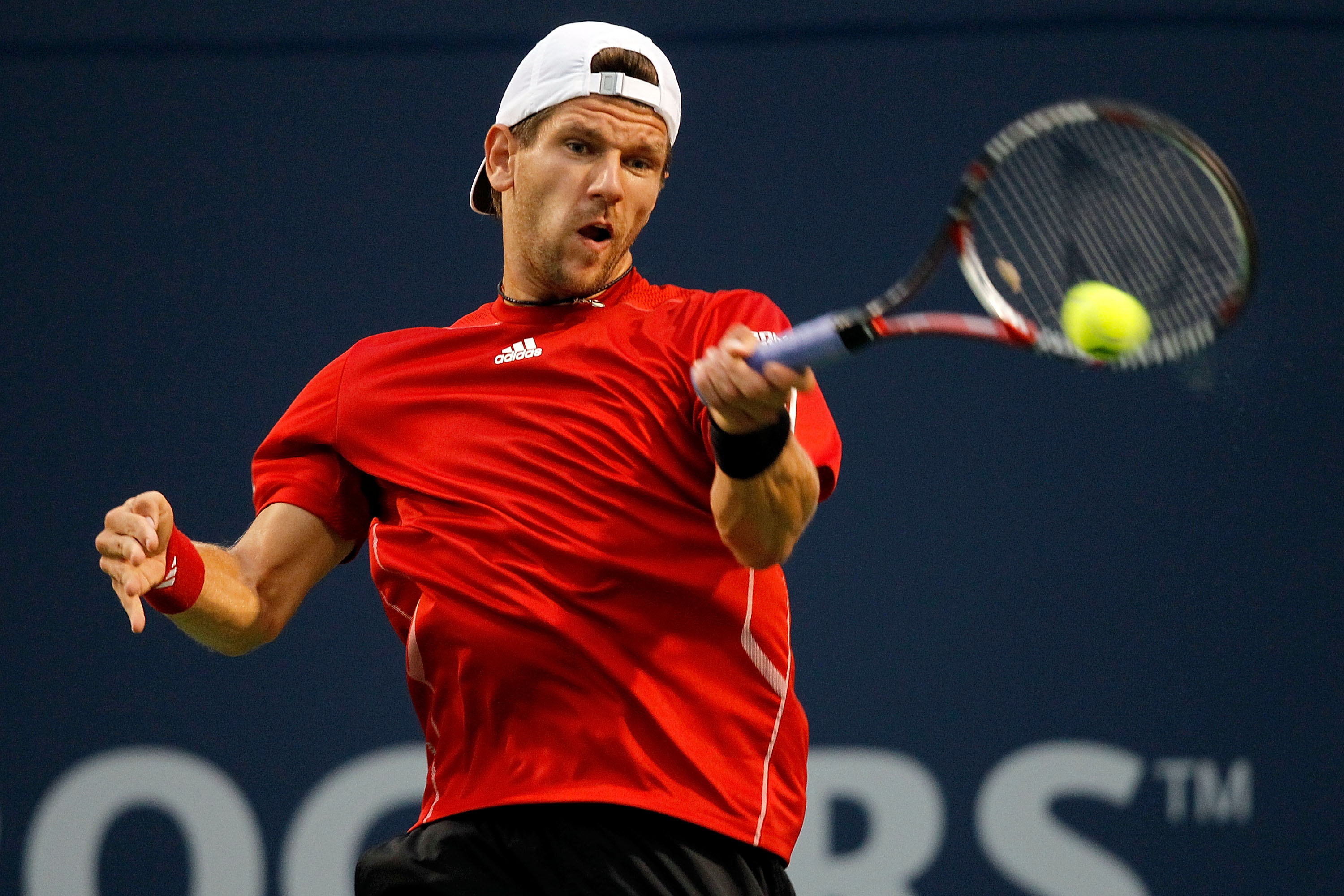 TORONTO, ON - AUGUST 09: Jurgen Melzer of Austria returns a shot to Peter Polansky of Canada during the Rogers Cup at the Rexall Centre on August 9, 2010 in Toronto, Canada.  (Photo by Matthew Stockman/Getty Images)