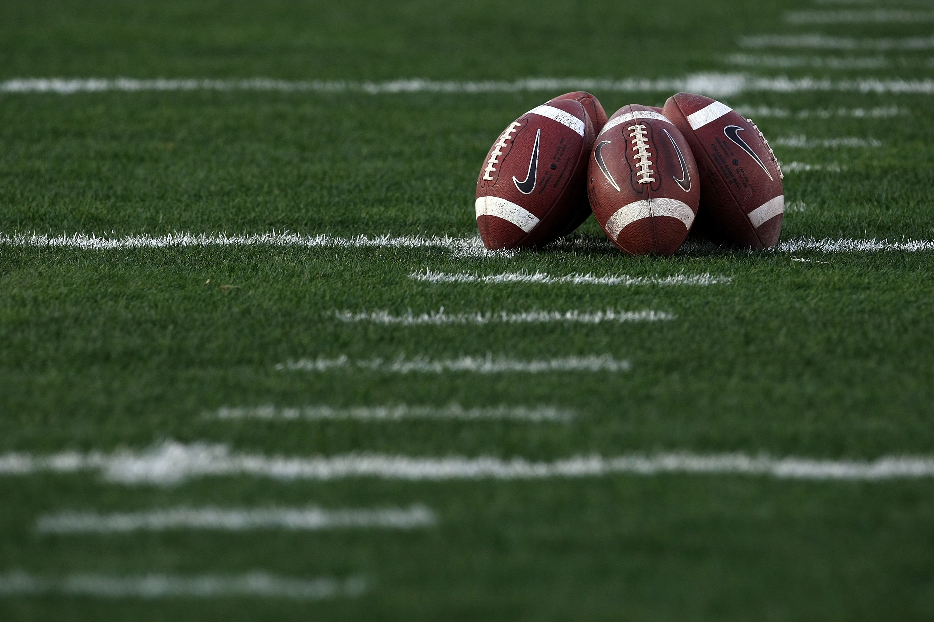 PASADENA, CA - JANUARY 07:  A detailed picture of footballs on the field prior to the Citi BCS National Championship game between the Texas Longhorns and the Alabama Crimson Tide at the Rose Bowl on January 7, 2010 in Pasadena, California.  (Photo by Step
