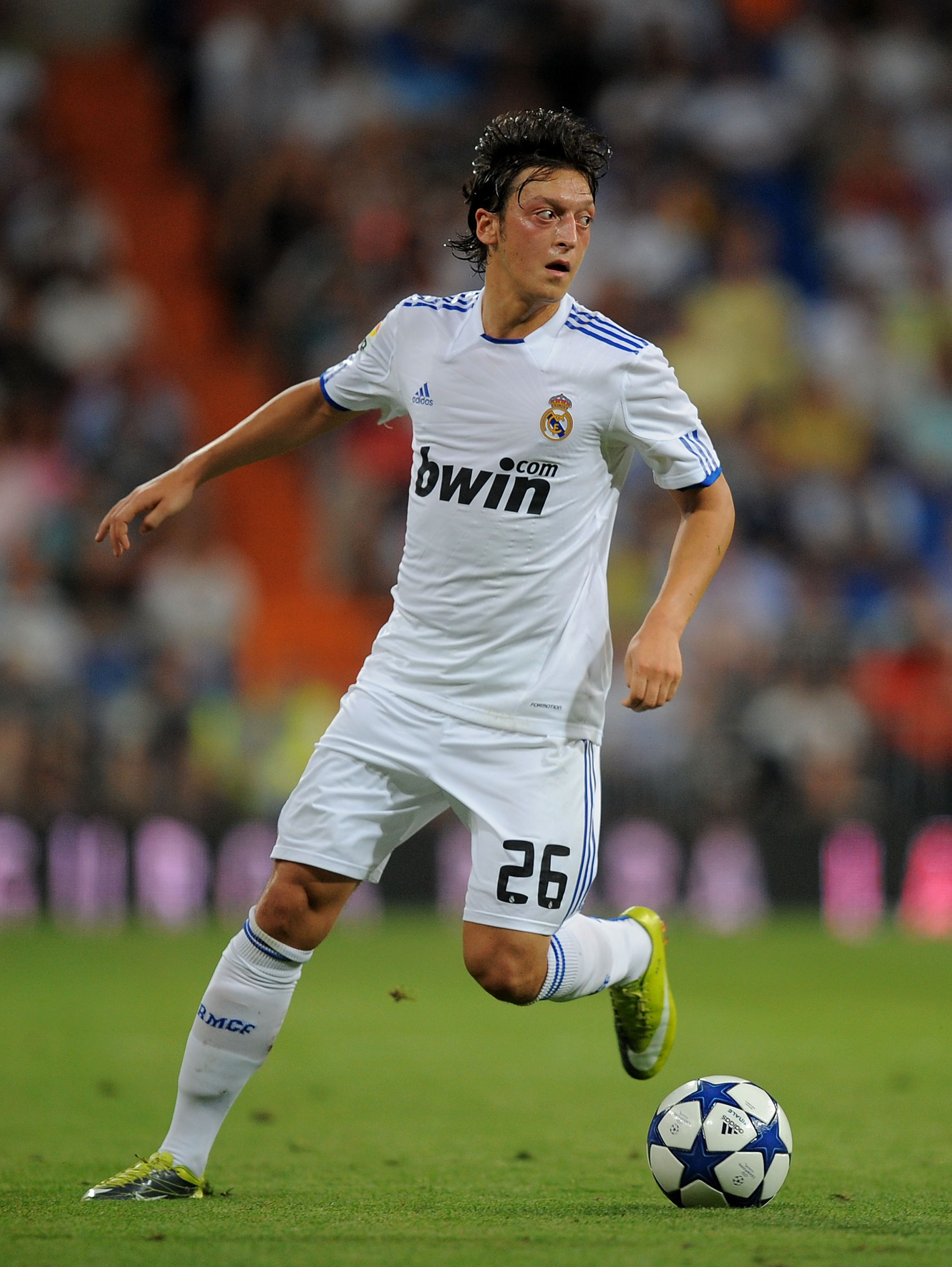 MADRID, SPAIN - AUGUST 24:  Mesut Ozil of Real Madrid in action during the Santiago Bernabeu Trophy match between Real Madrid and Penarol at the Santiago Bernabeu stadium on August 24, 2010 in Madrid, Spain.  (Photo by Denis Doyle/Getty Images)