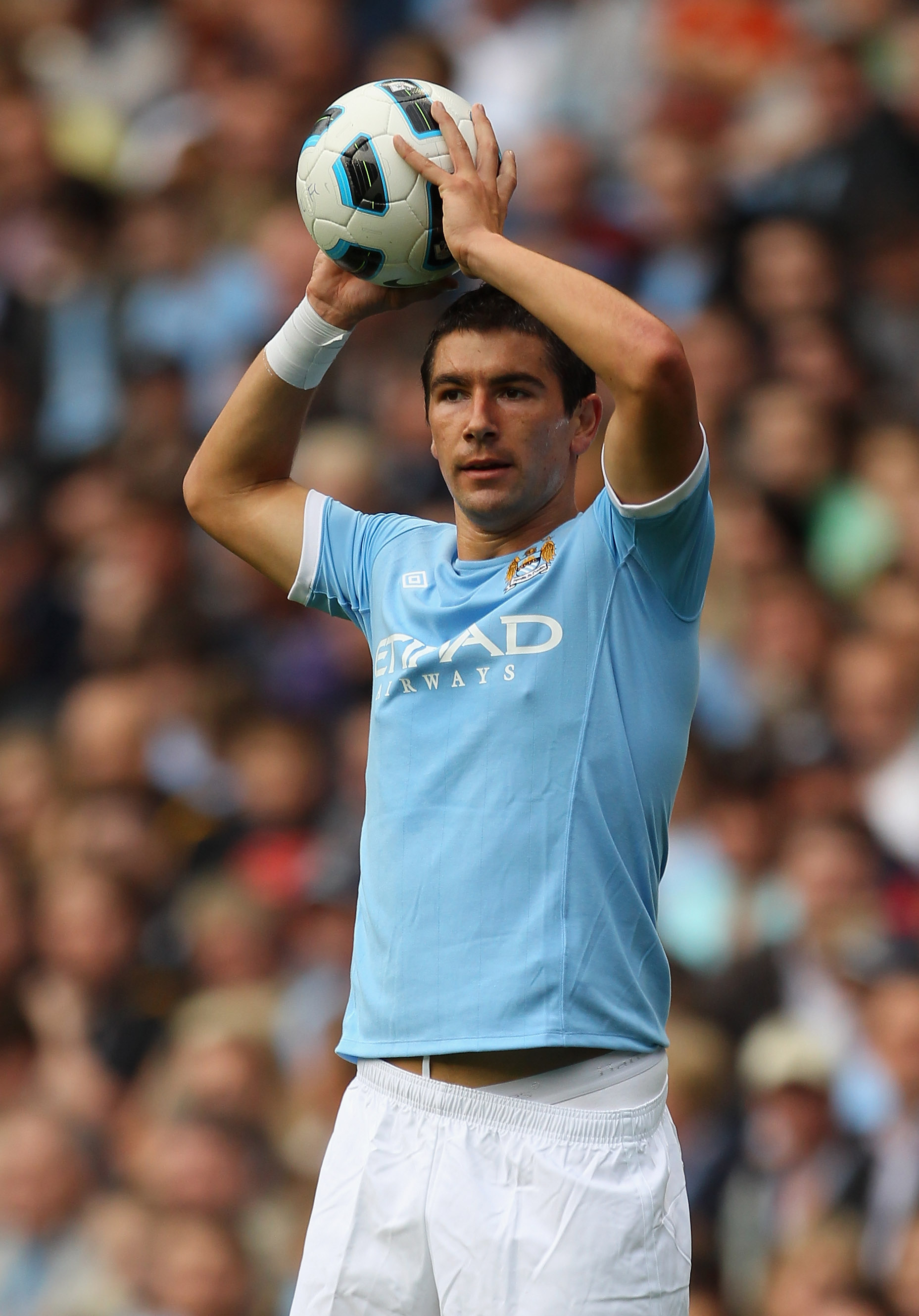 MANCHESTER, ENGLAND - AUGUST 07:  Aleksandar Kolarov of Manchester City takes a throw in during the pre-season friendly match between Manchester City and Valencia at the City of Manchester Stadium on August 7, 2010 in Manchester, England.  (Photo by Alex