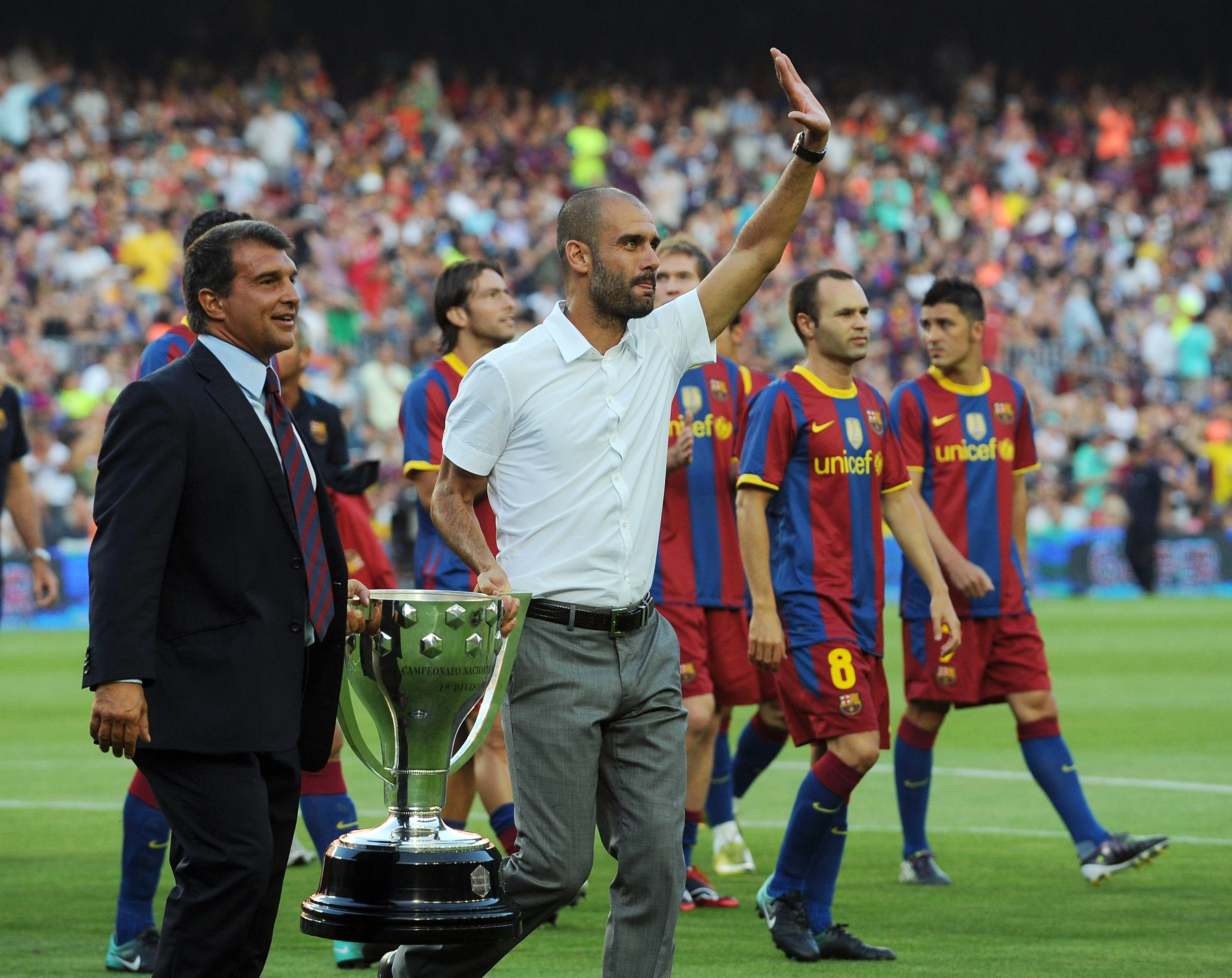 BARCELONA, SPAIN - AUGUST 25:  Former Barcelona president Joan Laparta (L) holds the 2009-2010 La Liga trophy with Barcelona manager Josep Guardiola during a lap of honour before the Joan Gamper Trophy match between Barcelona and AC Milan at Camp Nou stad