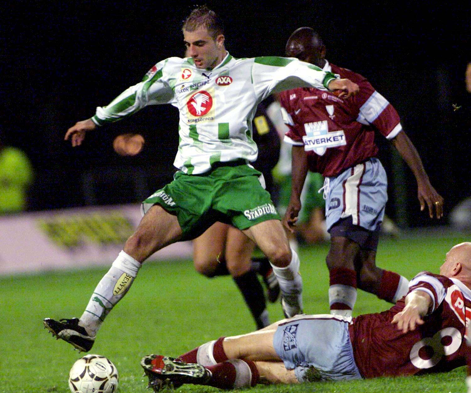 1 Sep 2001:  Hammarby's Kennedy Bakircioglu in action while Malmo's Peter Sorensen lies on the ground during the Swedish League soccer match played between Hammarby and Malmo the game ended 4-1. Hammarby lead the Swedish League. DIGITAL IMAGE.  MandatoryC
