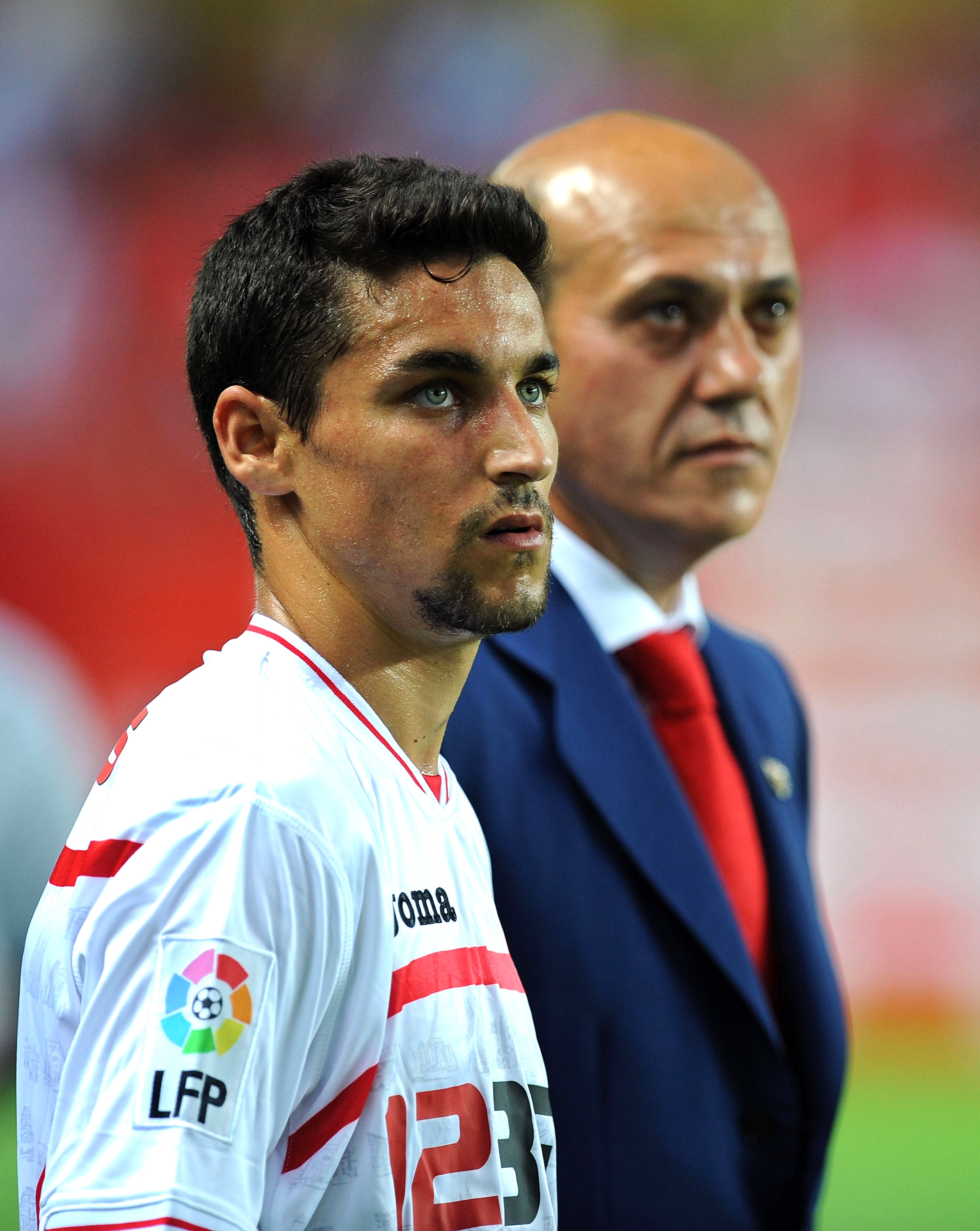 SEVILLE, SPAIN - AUGUST 14:  Jesus Navas (L) of Sevilla stands beside club president Jose Maria del Nido before the Supercopa, first leg, match between Sevilla and Barcelona at the Sanchez Pizjuan stadium  on August 14, 2010 in Seville, Spain.  (Photo by