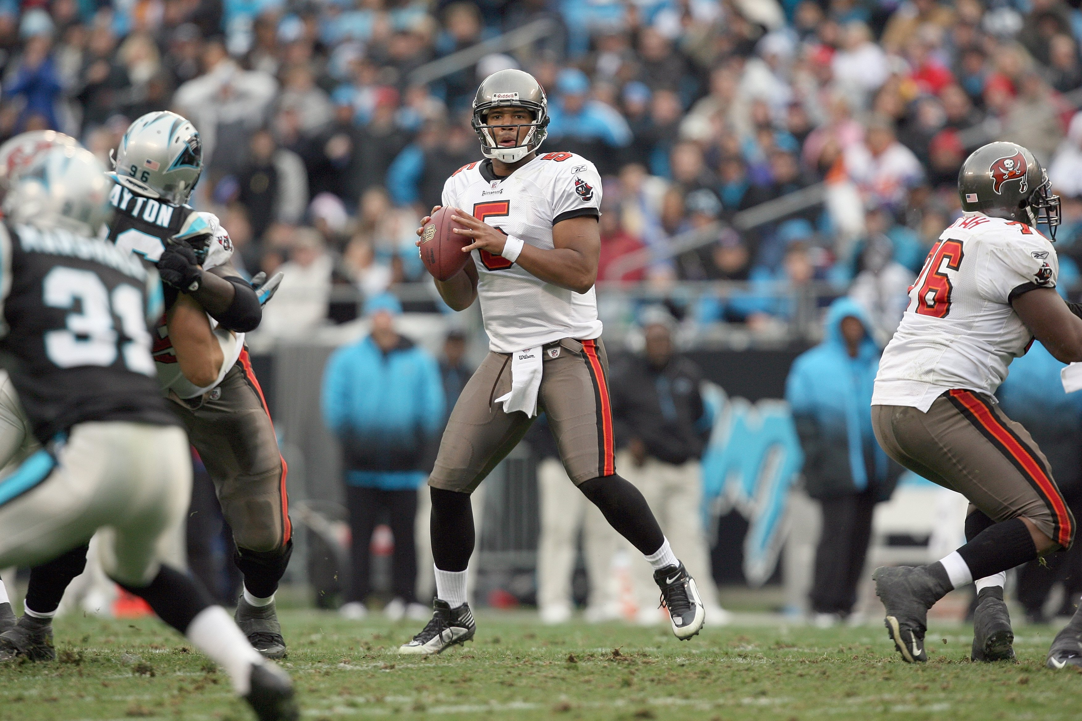 CHARLOTTE, NC - DECEMBER 06:  Josh Freeman #5 of the Tampa Bay Buccaneers looks to pass during the game against the Carolina Panthers at Bank of America Stadium on December 6, 2009 in Charlotte, North Carolina.  (Photo by Streeter Lecka/Getty Images)