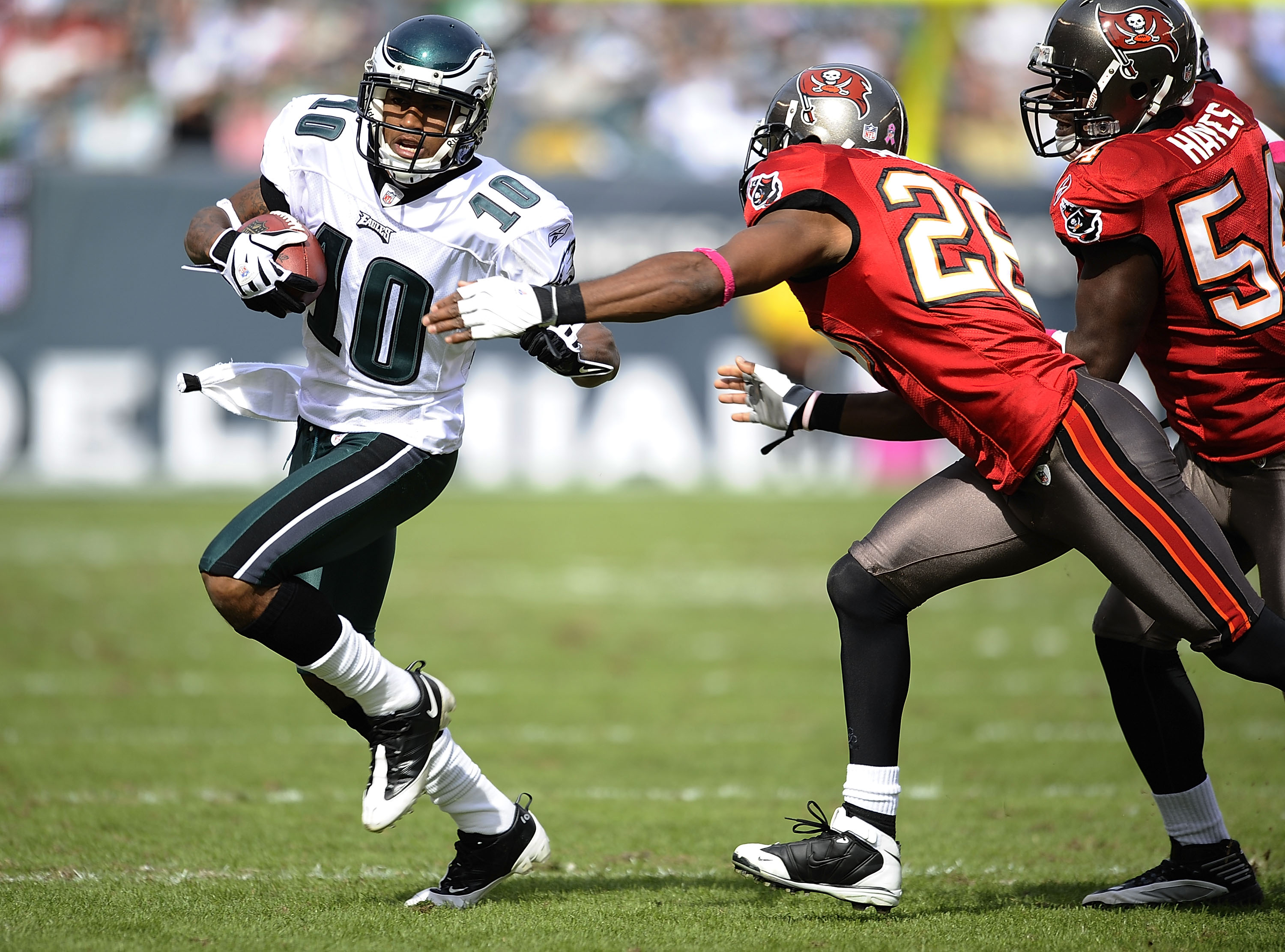 PHILADELPHIA - OCTOBER 11: DeSean Jackson #10 of the Philadelphia Eagles tries to get around Will Allen #26 and Geno Haynes #54 of the Tampa Bay Buccaneers at Lincoln Financial Field on October 11, 2009 in Philadelphia, Pennsylvania.  (Photo by Jeff Zelev