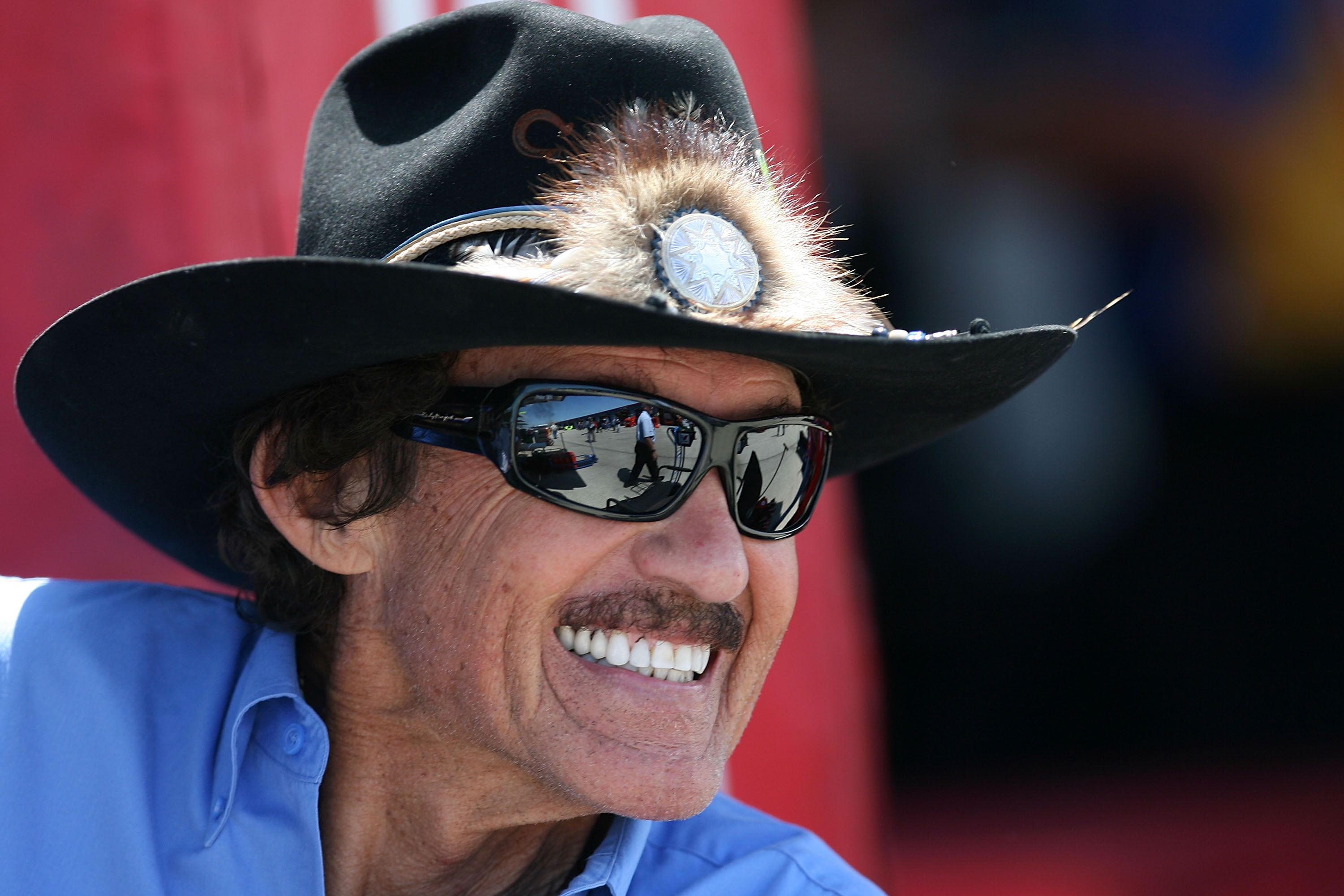 JOLIET, IL - JULY 09:  NASCAR legend Richard Petty looks on from the garage area during practice for the NASCAR Sprint Cup Series LIFELOCK.COM 400 at the Chicagoland Speedway on July 9, 2010 in Joliet, Illinois.  (Photo by Chris Trotman/Getty Images for N