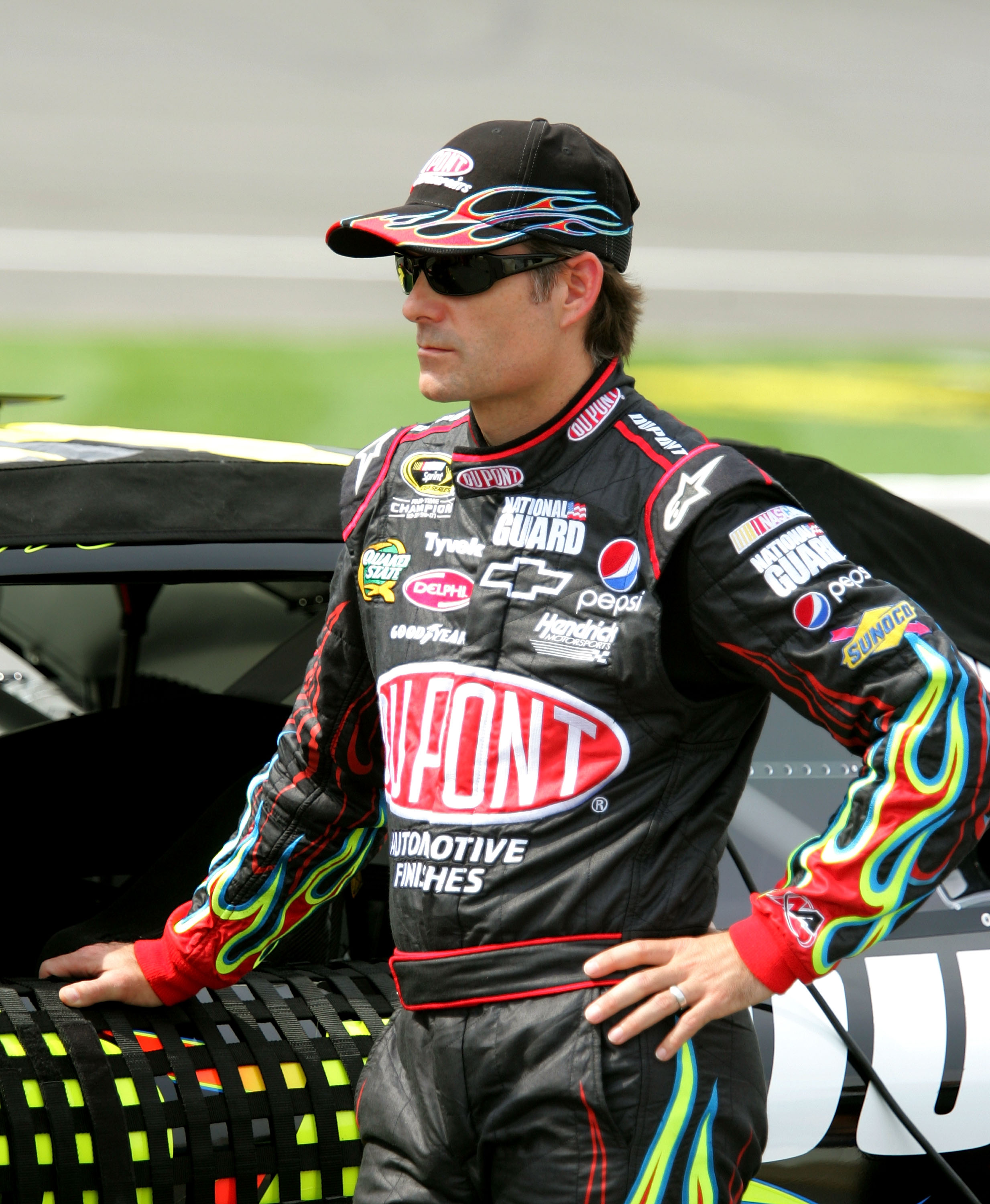 BROOKLYN, MI - AUGUST 13:  Jeff Gordon, driver of the #24 DuPont Chevrolet stands on pit road during qualifying for the NASCAR Sprint Cup Series CARFAX 400 at Michigan International Speedway on August 13, 2010 in Brooklyn, Michigan.  (Photo by Jerry Markl