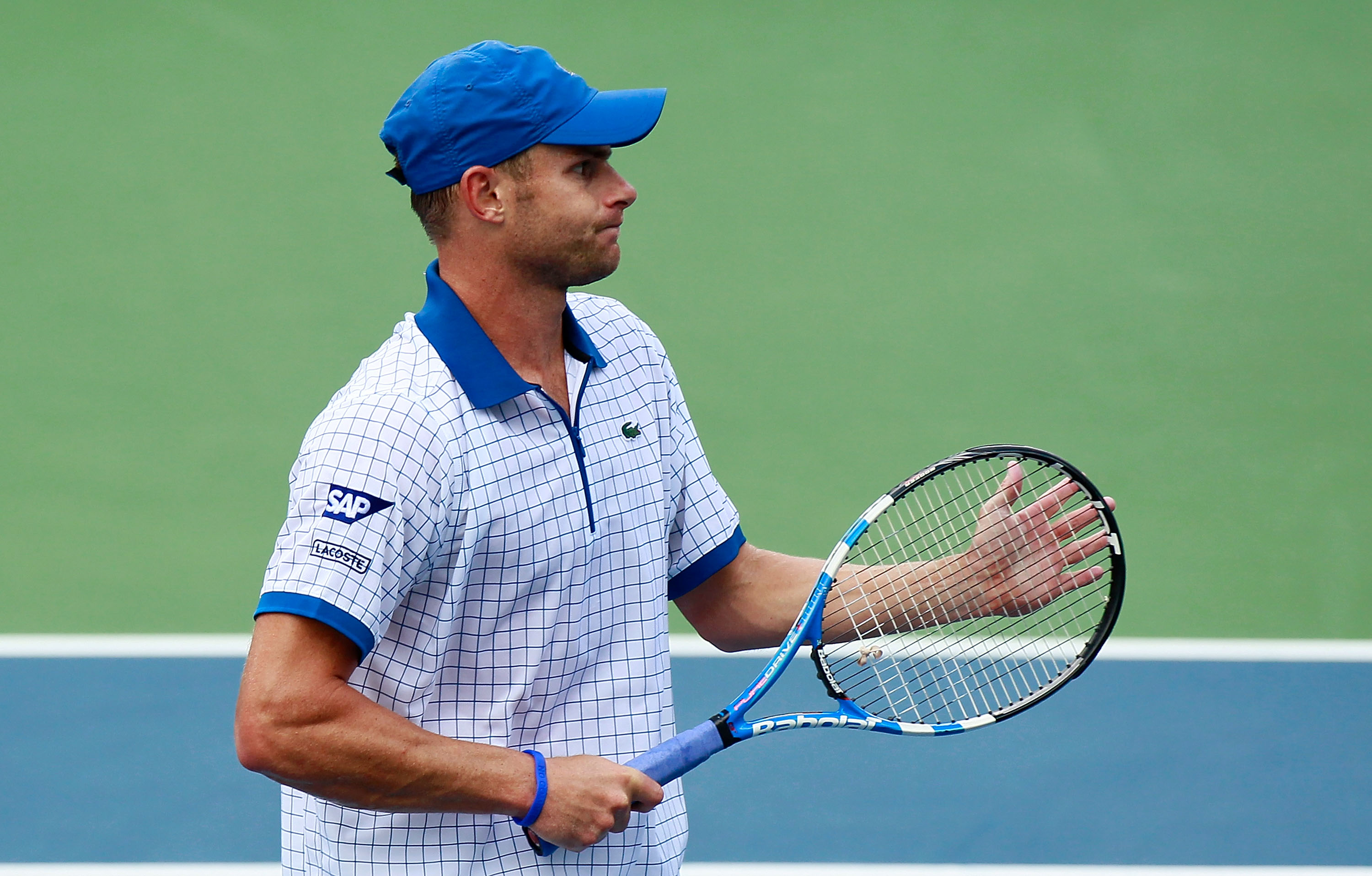 CINCINNATI - AUGUST 21:  Andy Roddick applauds a shot by Mardy Fish during the semifinals on Day 6 of the Western & Southern Financial Group Masters at the Lindner Family Tennis Center on August 21, 2010 in Cincinnati, Ohio.  (Photo by Kevin C. Cox/Getty