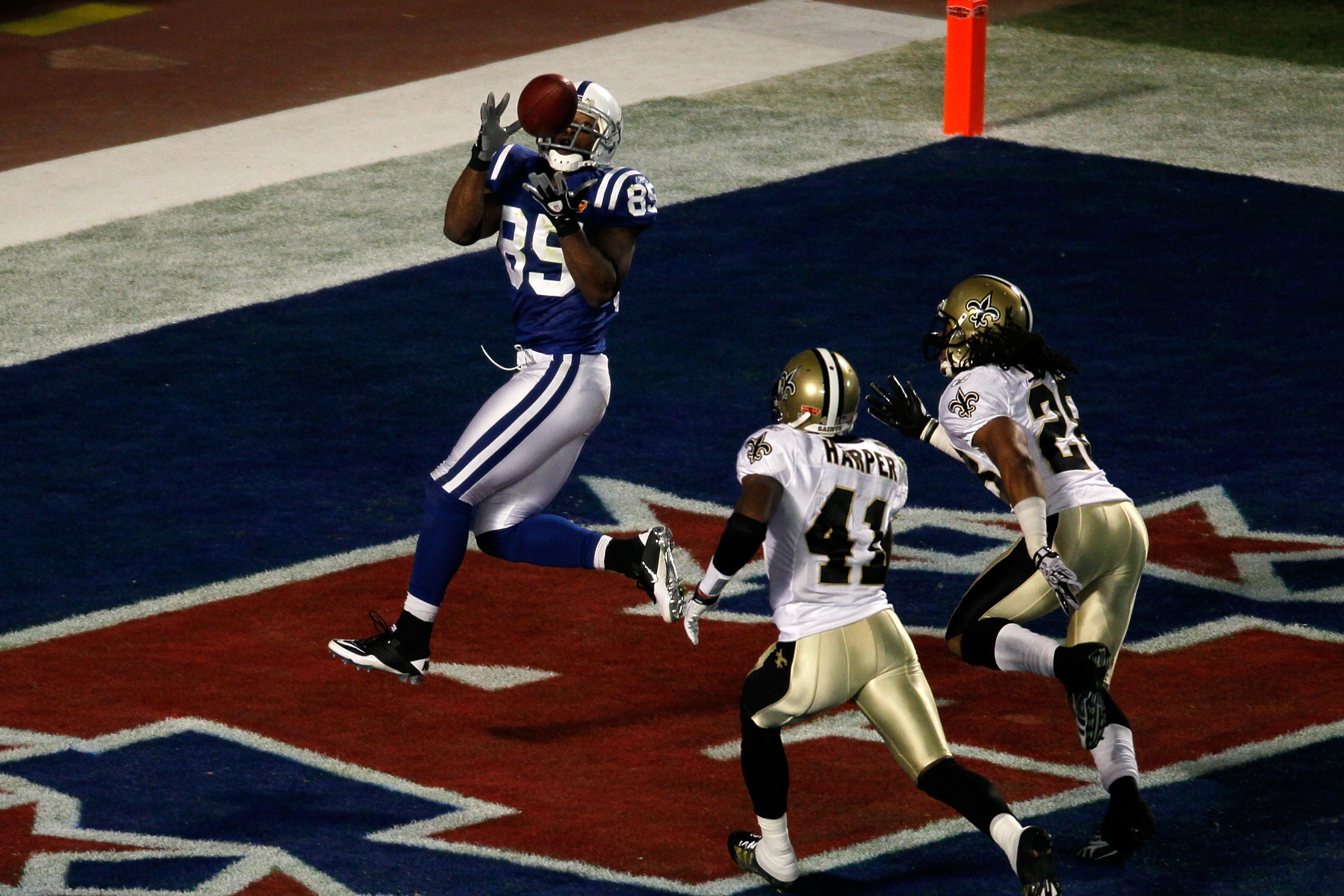 MIAMI GARDENS, FL - FEBRUARY 07:  Pierre Garcon #85 of the Indianapolis Colts catches a touchdown pass in the first quarter against the New Orleans Saints during Super Bowl XLIV on February 7, 2010 at Sun Life Stadium in Miami Gardens, Florida.  (Photo by