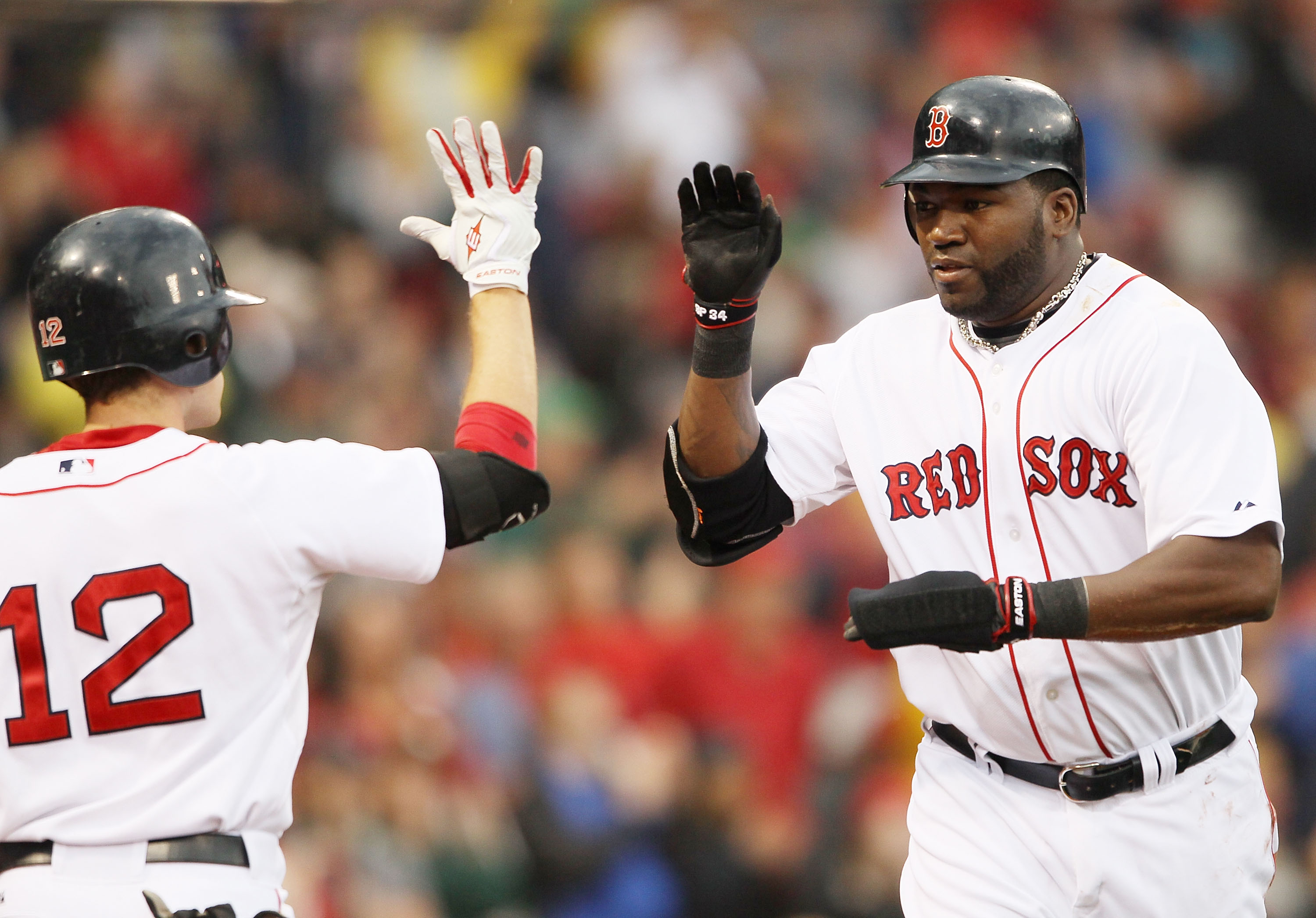 BOSTON - AUGUST 22:  David Ortiz #34 of the Boston Red Sox celebrates his run with teammate Jed Lowrie #12 in the fifth inning against the Toronto Blue Jays on August 22, 2010 at Fenway Park in Boston, Massachusetts.  (Photo by Elsa/Getty Images)