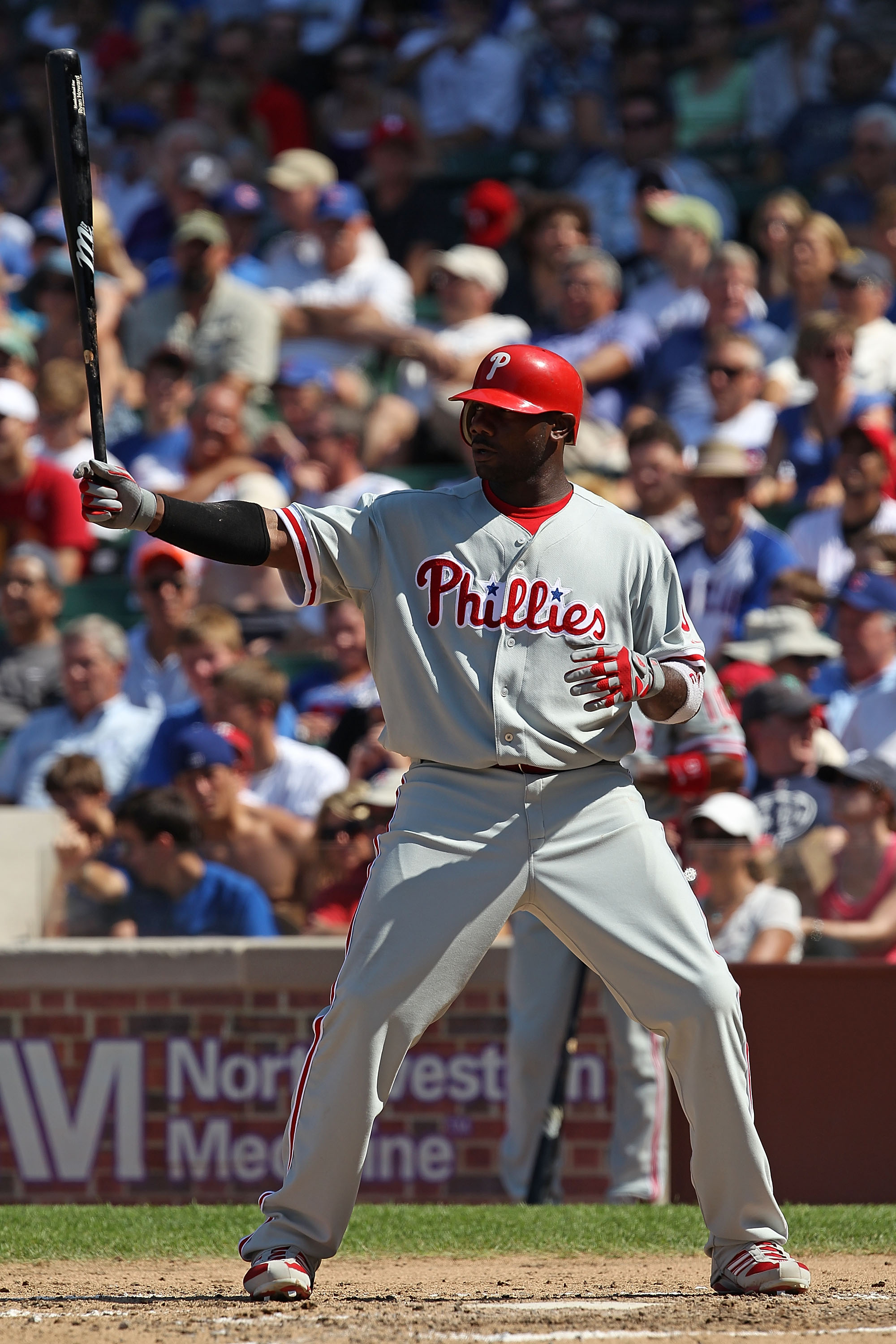 CHICAGO - JULY 16: Ryan Howard #6 of the Philadelphia Phillies waits to bat against the Chicago Cubs at Wrigley Field on July 16, 2010 in Chicago, Illinois. The Cubs defeated the Phillies 4-3. (Photo by Jonathan Daniel/Getty Images)
