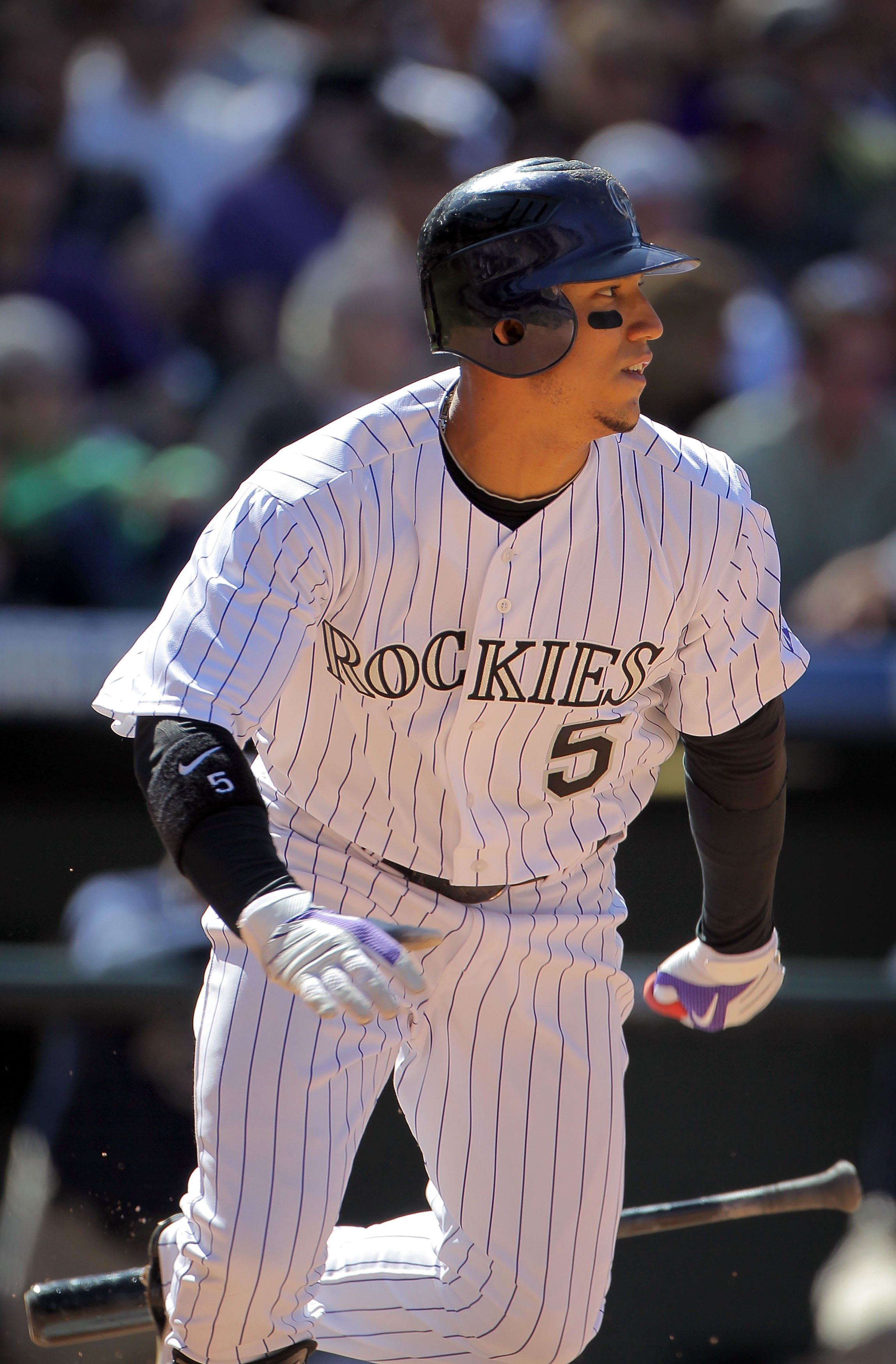 DENVER - APRIL 09:  Carlos Gonzalez #5 of the Colorado Rockies heads for first base as he takes an at bat against the San Diego Padres during MLB action on Opening Day at Coors Field on April 9, 2010 in Denver, Colorado. The Rockies defeated the Padres 7-