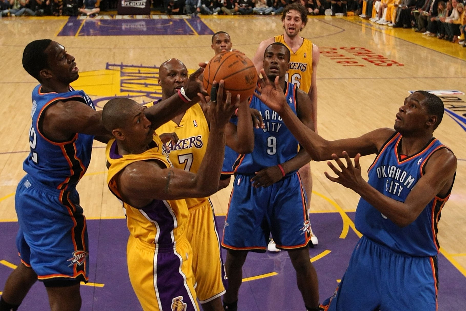 LOS ANGELES, CA - APRIL 27:  Ron Artest #37 of the Los Angeles Lakers rebounds the ball between Jeff Green #22 and Kevin Durant #35 of the Oklahoma City Thunder during Game Five of the Western Conference Quarterfinals of the 2010 NBA Playoffs at Staples C