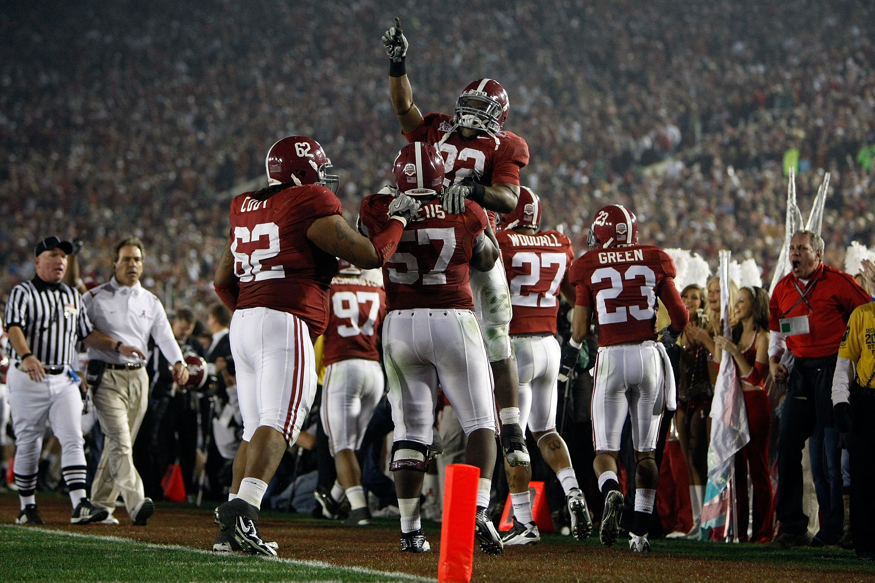 PASADENA, CA - JANUARY 07:  Running back Mark Ingram #22 jumps on lineman Marcell Dareus #57 of the Alabama Crimson Tide as they celebrate with teammates after Dareus' 28-yard interception return for a touchdown against the Texas Longhorns during the seco