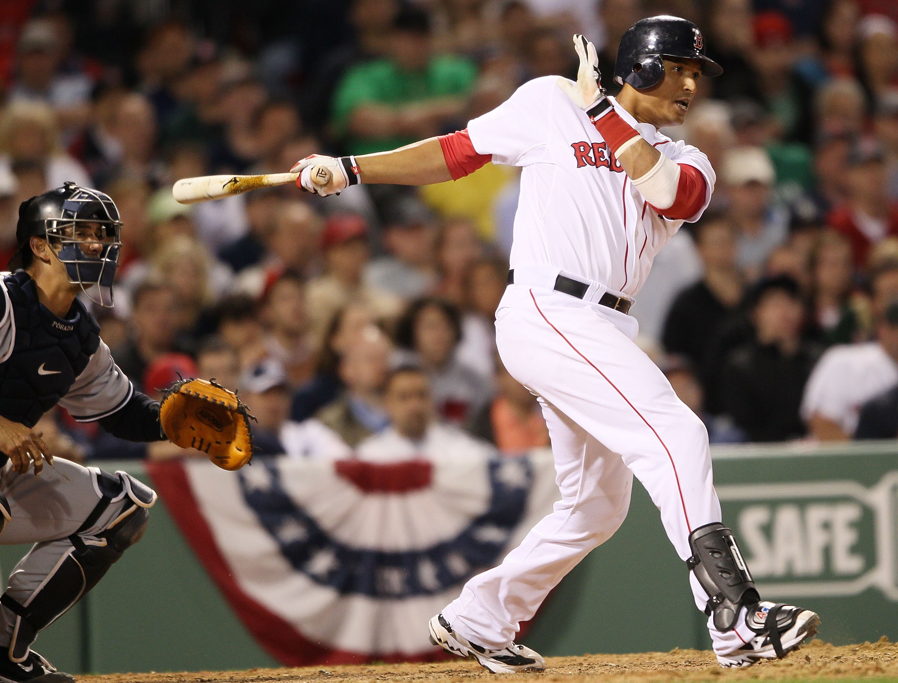 BOSTON - APRIL 04:  Victor Martinez #41 of the Boston Red Sox takes a swing as Jorge Posada #20 of the New York Yankees defends on April 4, 2010 during Opening Night at Fenway Park in Boston, Massachusetts.  (Photo by Elsa/Getty Images)