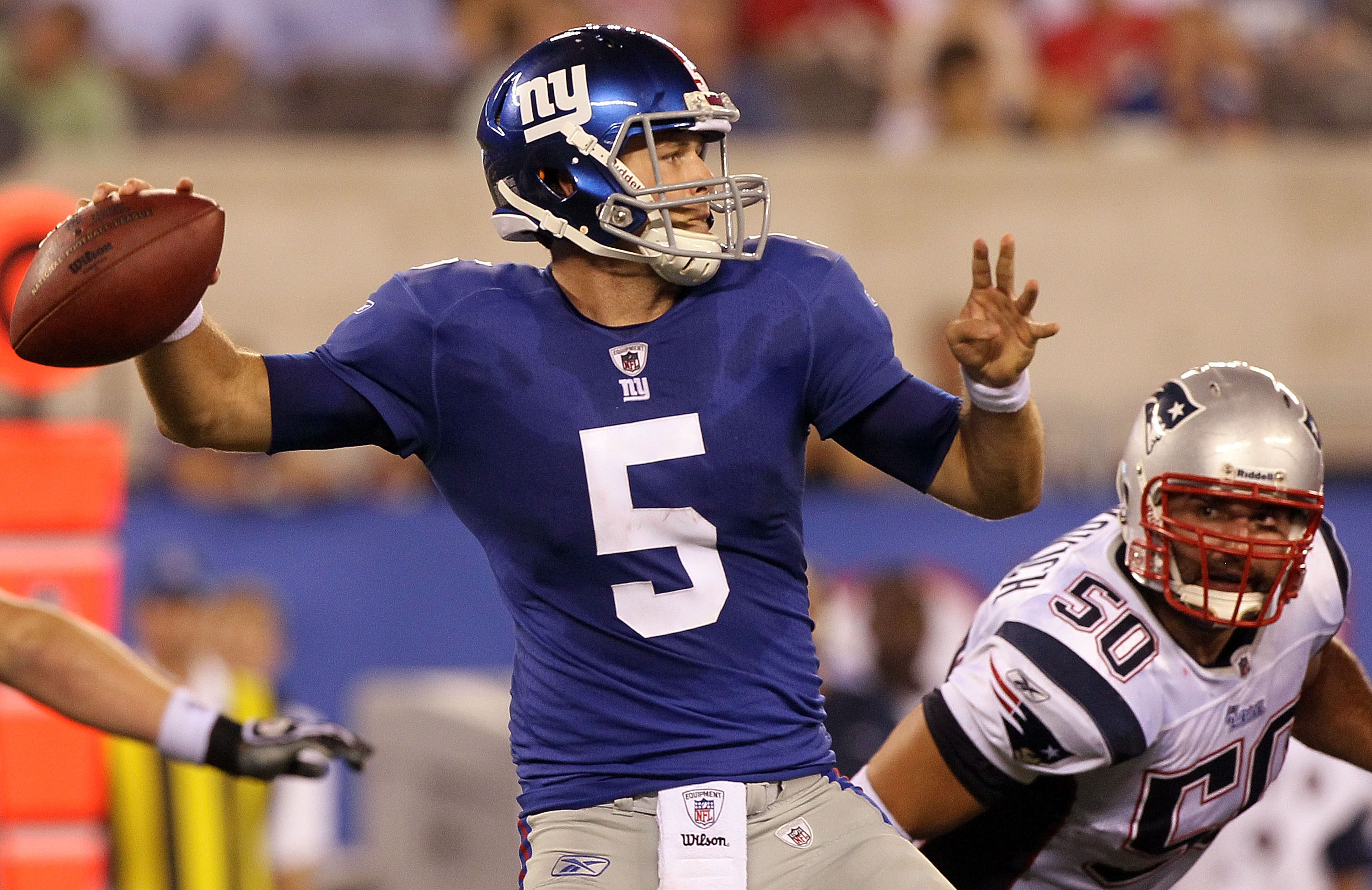 EAST RUTHERFORD, NJ - SEPTEMBER 02:  Rhett Bomar #5 of the New York Giants throws a pass against the New England Patriots on September 2, 2010 at the New Meadowlands Stadium in East Rutherford, New Jersey. The Giants defeated the Patriots 20-17.  (Photo b
