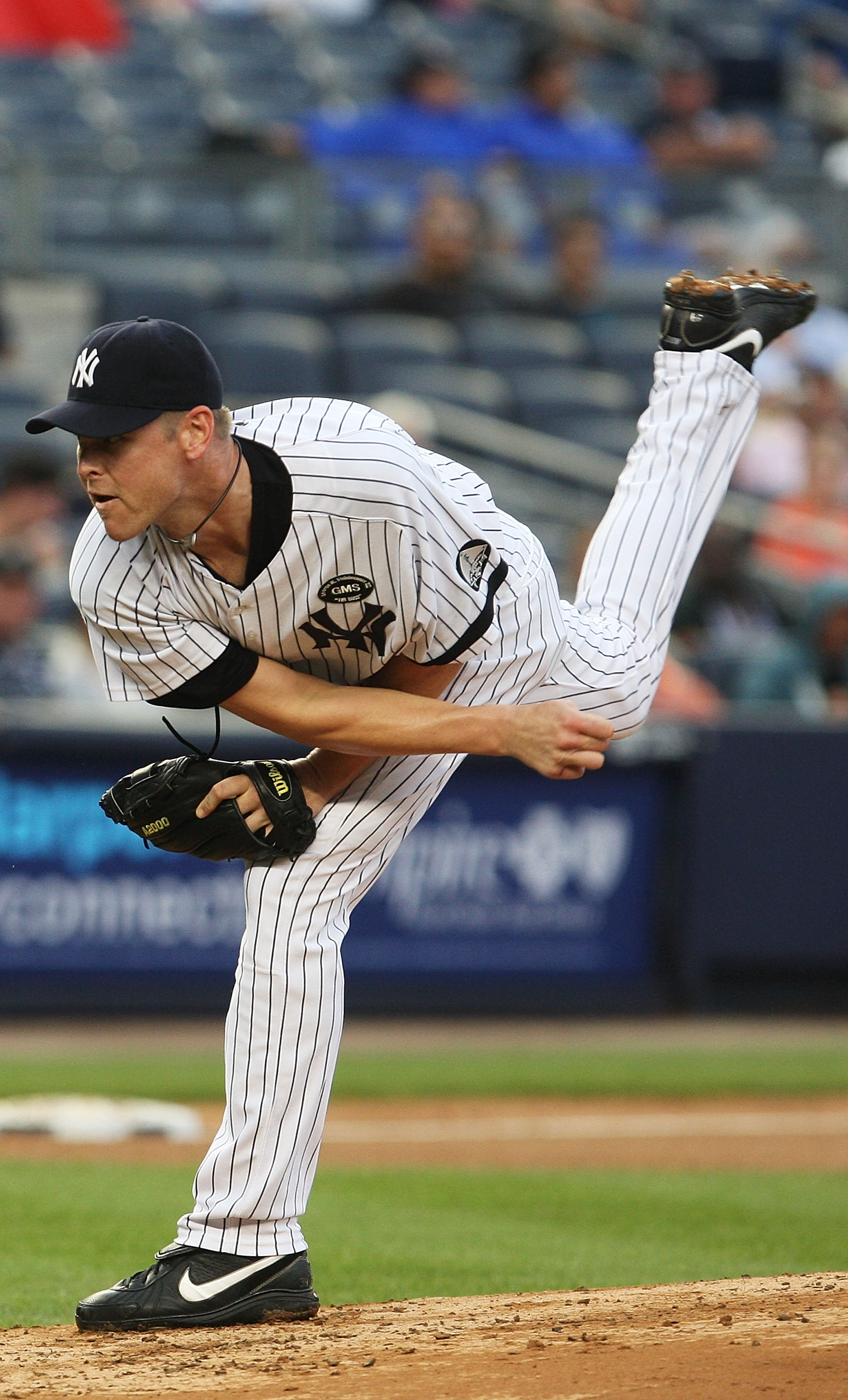 NEW YORK - AUGUST 22:  Kerry Wood #39 of the New York Yankees pitches against the Seattle Mariners on August 22, 2010 at Yankee Stadium in the Bronx borough of New York City.  (Photo by Andrew Burton/Getty Images)