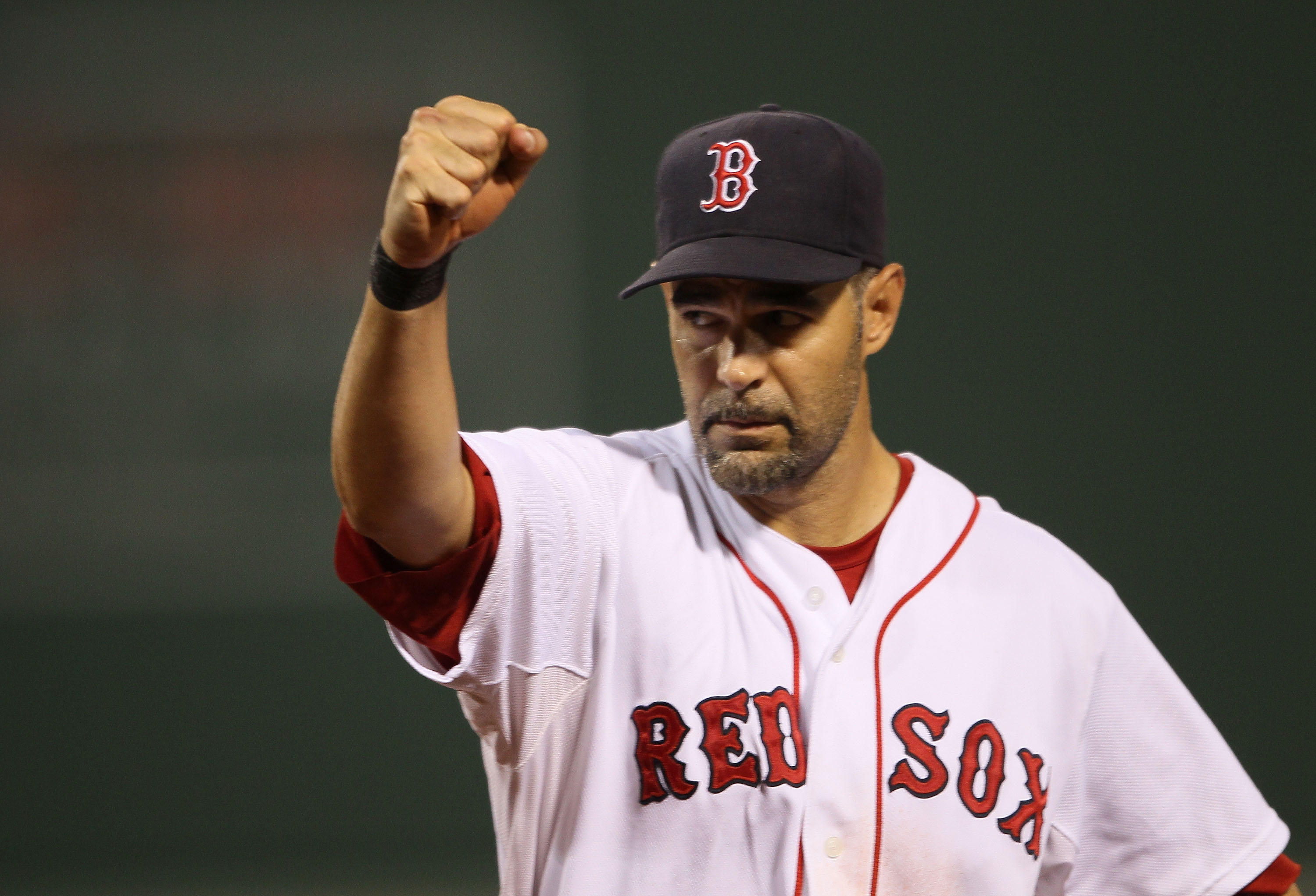 BOSTON - AUGUST 19:  Mike Lowell #25 of the Boston Red Sox celebrates as teammate J.D. Drew makes the catch for the final out of the third inning against the Los Angeles Angels of Anaheim on August 19, 2010 at Fenway Park in Boston, Massachusetts.  (Photo
