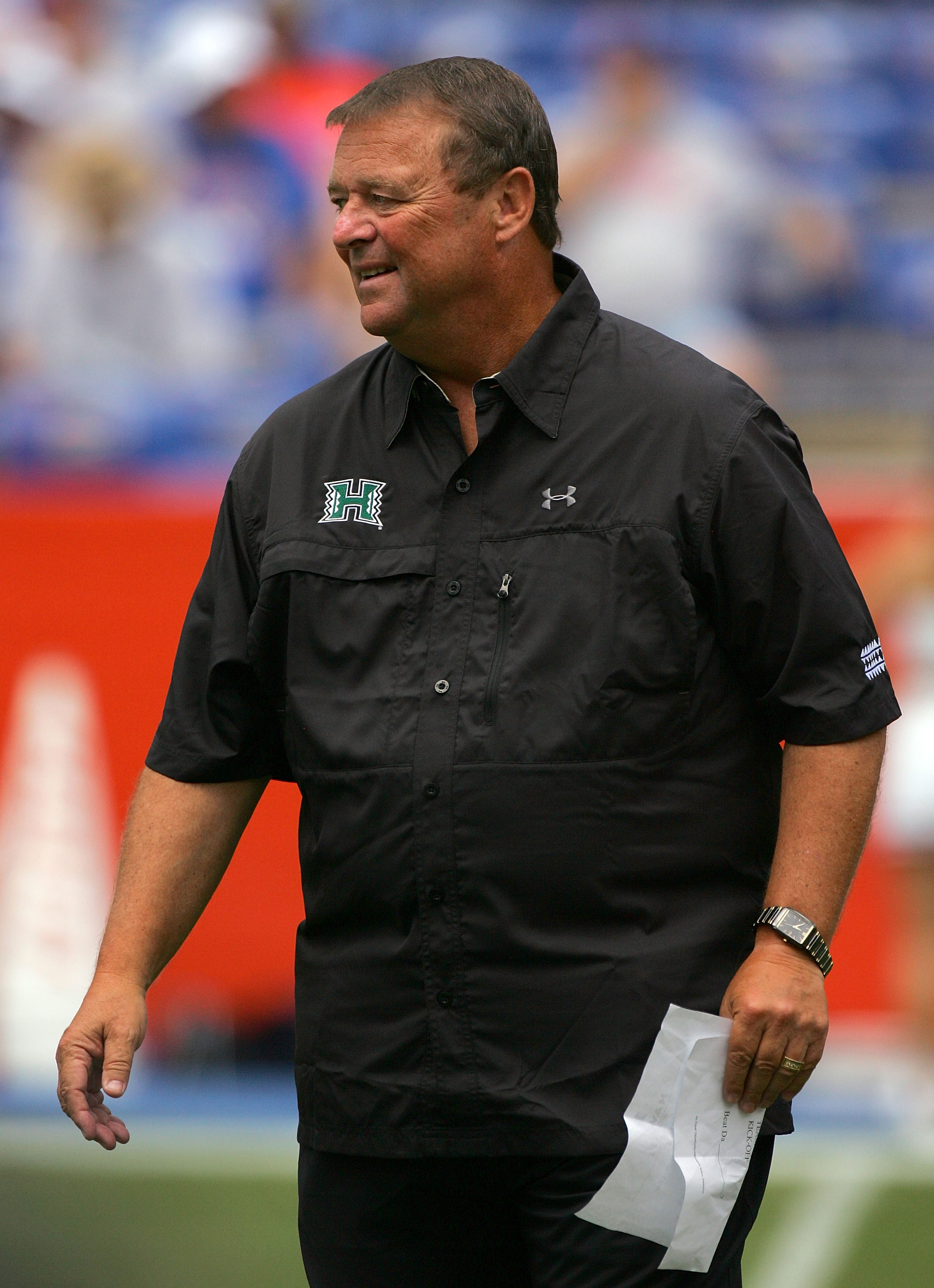 GAINESVILLE, FL - AUGUST 30:  Head coach Greg McMackin of the Hawaii Warriors sends in signals during the game against the Florida Gators at Ben Hill Griffin Stadium on August 30, 2008 in Gainesville, Florida.  (Photo by Sam Greenwood/Getty Images)