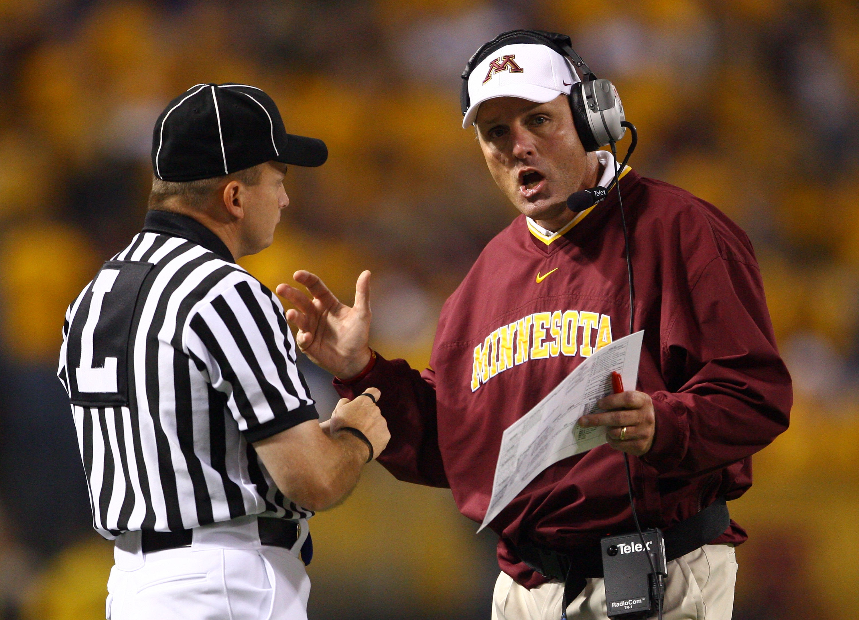 MINNEAPOLIS - SEPTEMBER 13:  Minnesota Golden Gophers' head coach Tim Brewster talks with an official during the game against the Montana State Bobcats at the Metrodome on September 13, 2008 in Minneapolis, Minnesota. Minnesota defeated Montana State 35-2