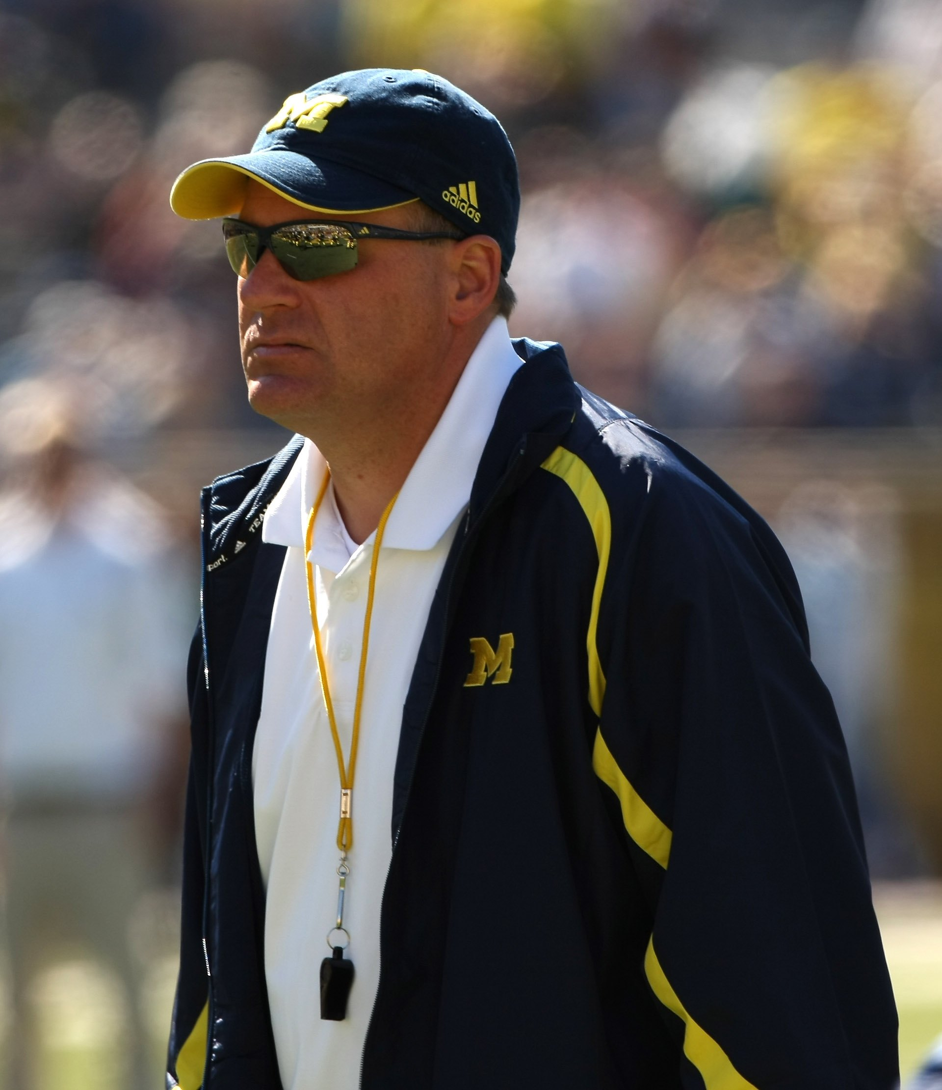 ANN ARBOR, MI - SEPTEMBER 19:  Head coach Rich Rodriguez of the Michigan Wolverines watches warmups before the game with the Eastern Michigan Eagles at Michigan Stadium on September 19, 2009 in Ann Arbor, Michigan.  Michigan won 45-17.  (Photo by Stephen