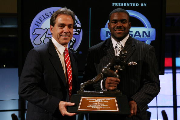 NEW YORK - DECEMBER 12: Running back Mark Ingram (R) #22 of the Alabama Crimson Tide poses with Head coach Nick Saban (L) and the Heisman Trophy during a press conference after being named the 75th Heisman Trophy winner at the Marriott Marquis on December