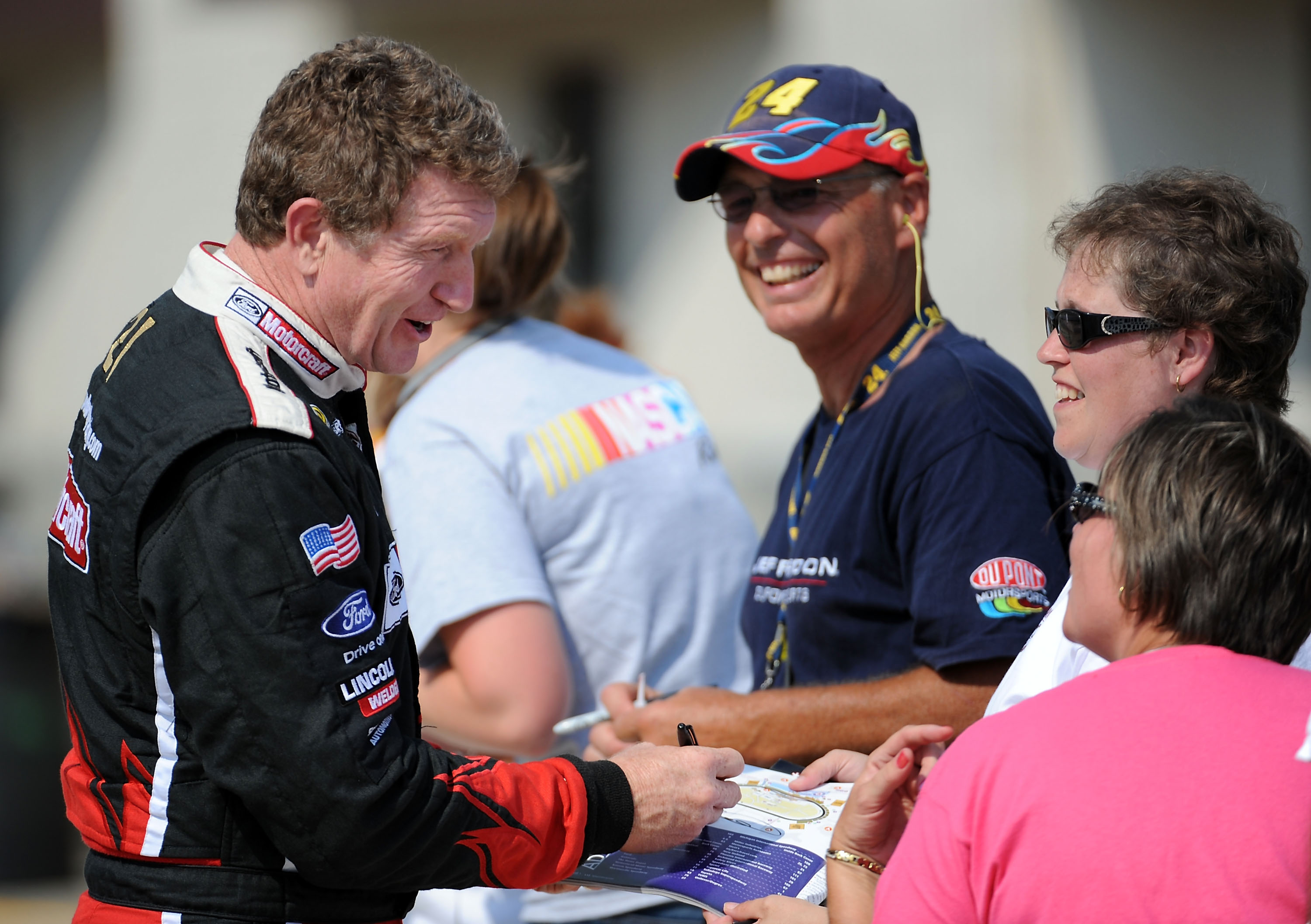BROOKLYN, MI - AUGUST 14:  Bill Elliott, driver of the #21 Motorcraft Ford, signs autographs during practice for the NASCAR Sprint Cup Series Michigan 400 at Michigan Internetional Speedway on August 14, 2009 in Brooklyn, Michigan.  (Photo by Harry How/Ge