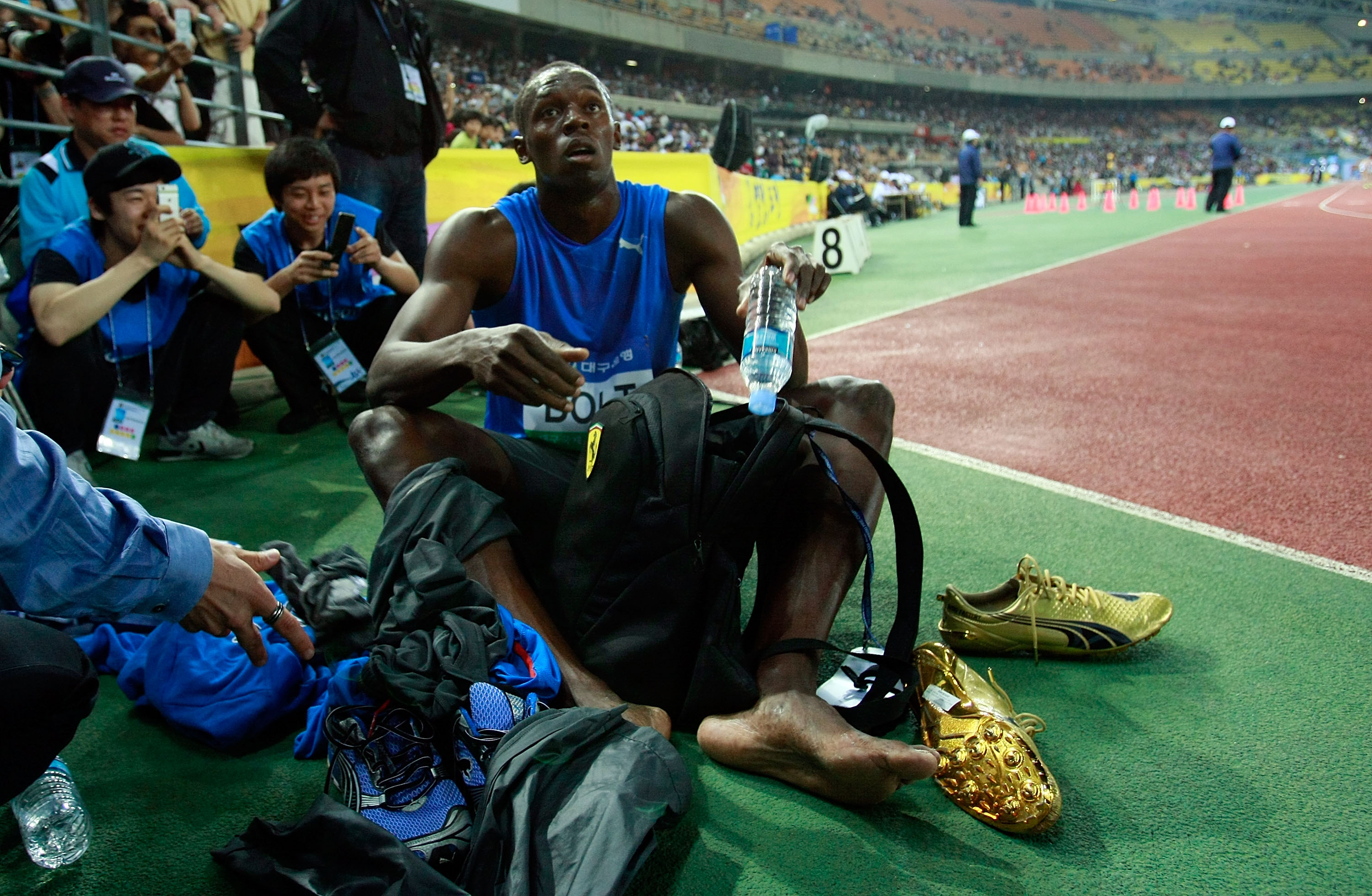 DAEGU, SOUTH KOREA - MAY 19:  Usain Bolt of Jamaica rests after winning the men's 100 metre race during the Colorful Daegu Pre-Championships Meeting 2010 at Daegu Stadium on May 19, 2010 in Daegu, South Korea. Bolt won the race at 9.86.  (Photo by Chung S