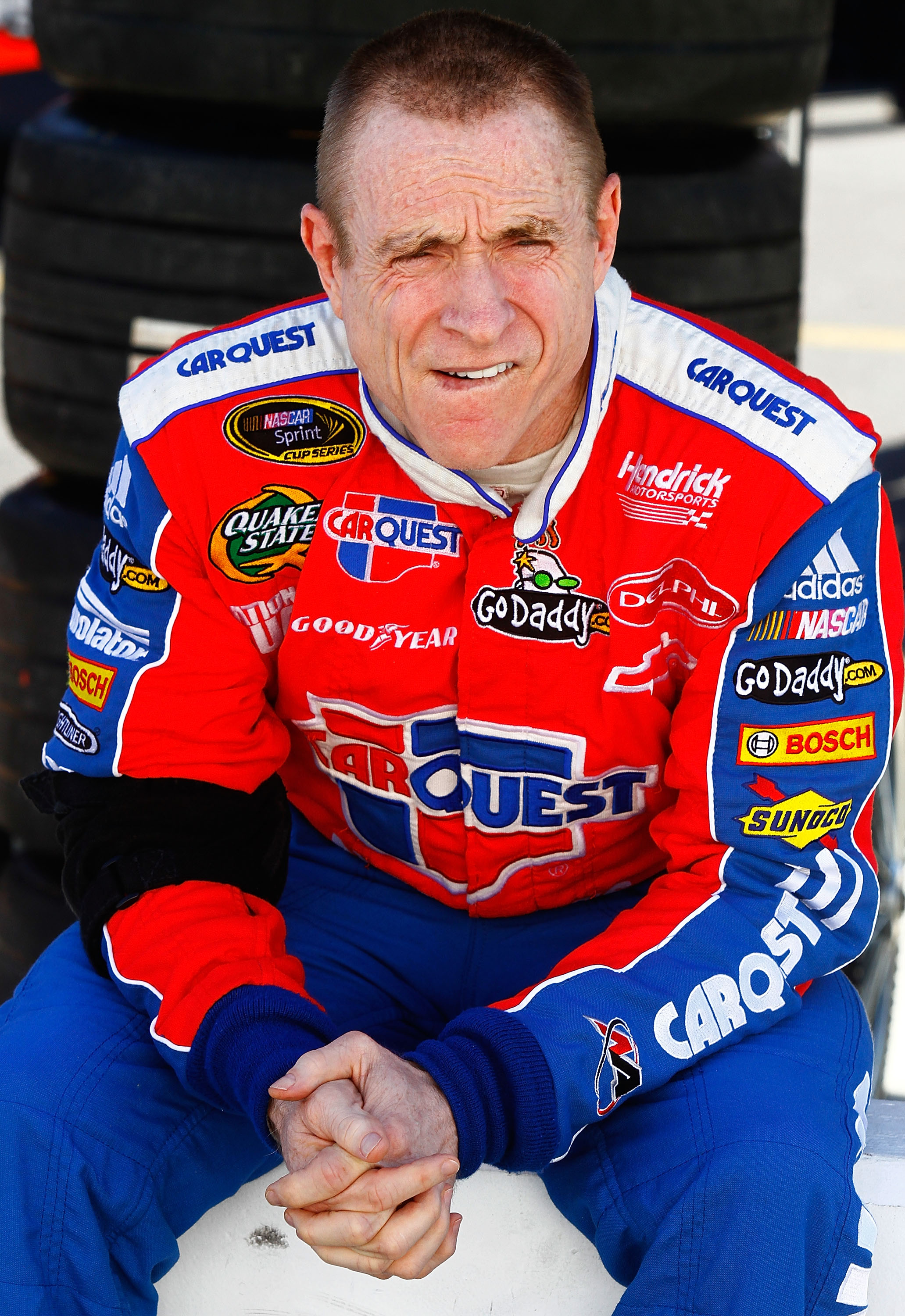 BRISTOL, TN - AUGUST 20:  Mark Martin, driver of the #5 CARQUEST Auto Parts Chevrolet, sits on pit wall during qualifying for the NASCAR Sprint Cup Series IRWIN Tools Night Race at Bristol Motor Speedway on August 20, 2010 in Bristol, Tennessee.  (Photo b