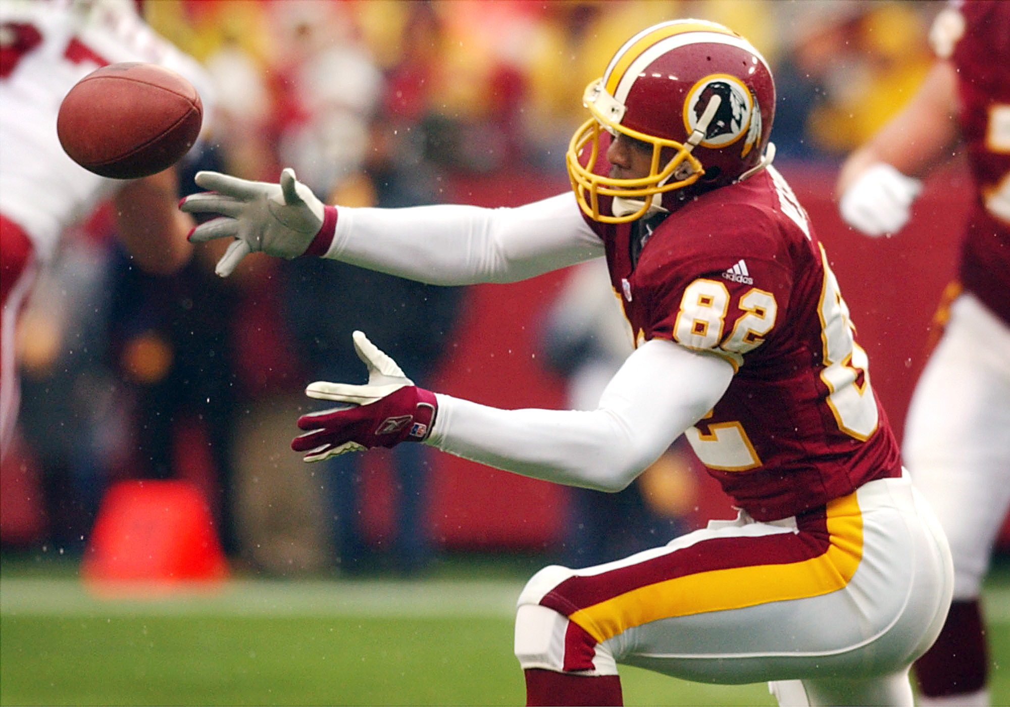 06 Jan 2002:  Michael Westbrook #82 of the Washington Redskins is unable to get a handle on a pass against the Arizona Cardinals during week 17 NFL action at FedEx Field in Landover, Maryland. DIGITAL IMAGE. Mandatory Credit: Doug Pensinger/Getty Images
