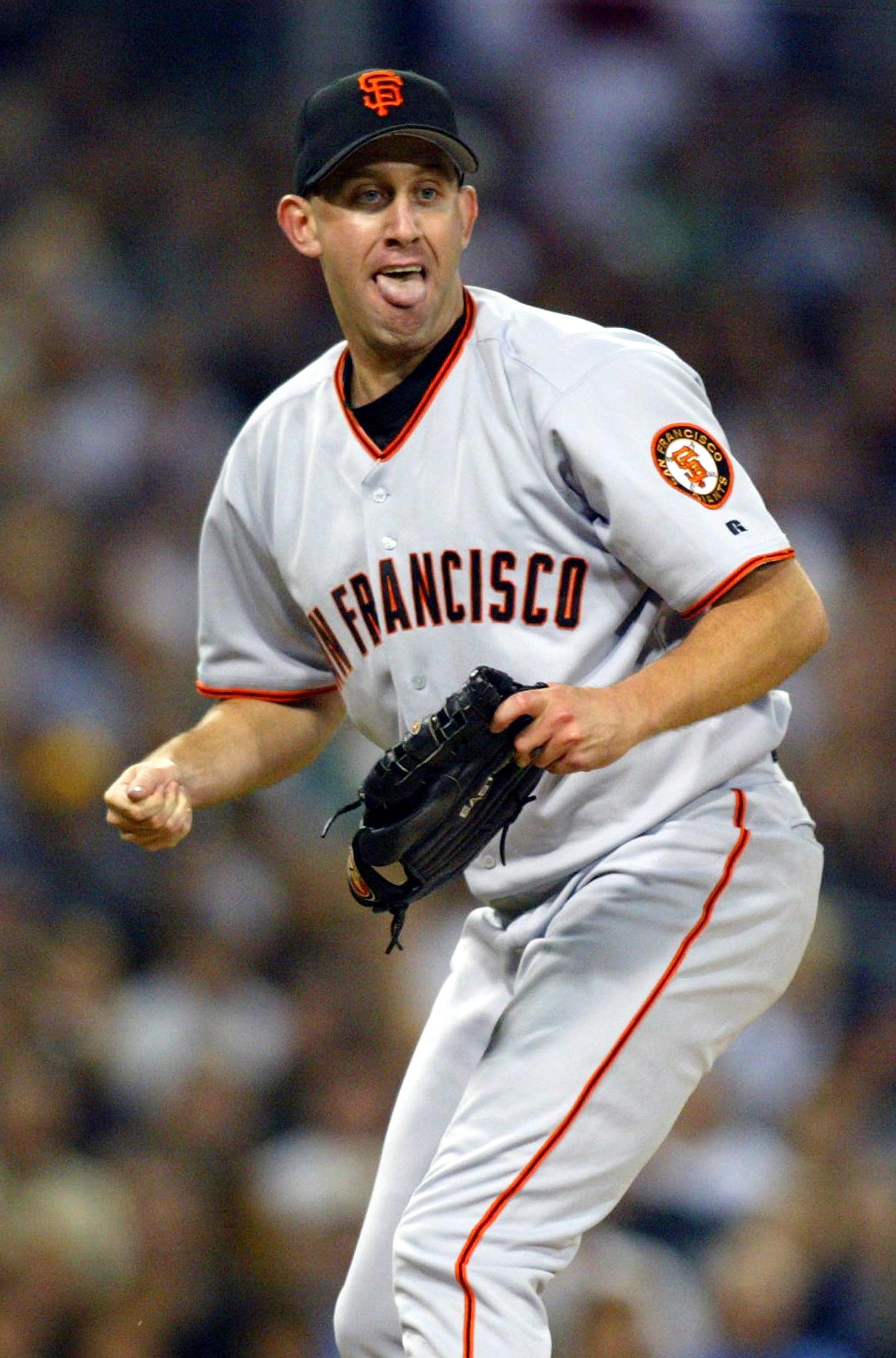 SAN DIEGO, CA - APRIL 10:   Pitcher Kirk Reuter #46 of the San Francisco Giants reacts after getting hit by a ball during their game against the San Diego Padres at Petco Park on April 10, 2004 in San Diego, California.  (Photo by Donald Miralle/Getty Ima