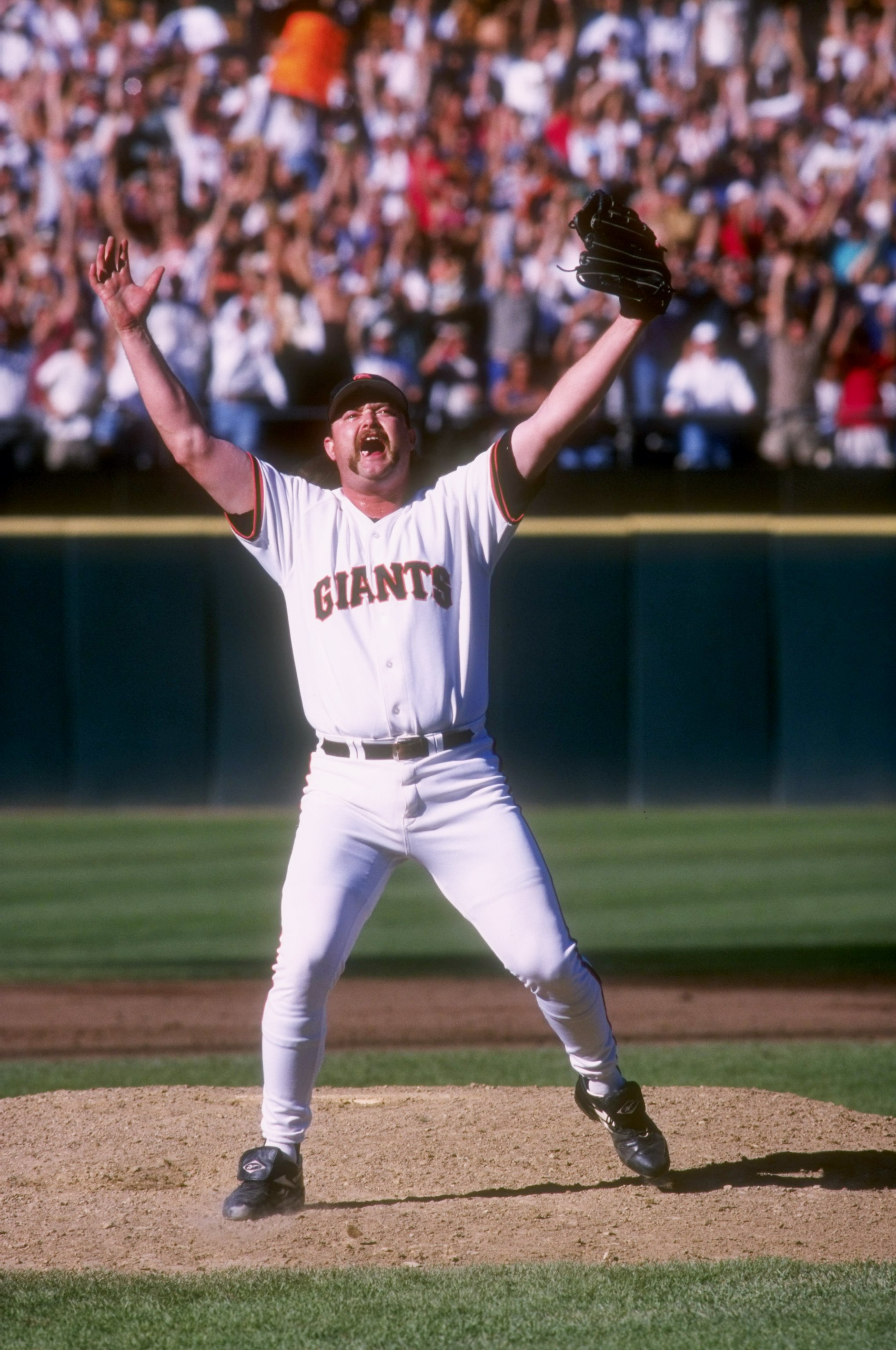 27 Sep 1997:  Closer Rod Beck of the San Francisco Giants celebrates on the mound after the Giants 6-1 victory over the San Diego Padres at 3Com Park in San Francisco, California.  The victory clinched the National League West title for the Giants and sen