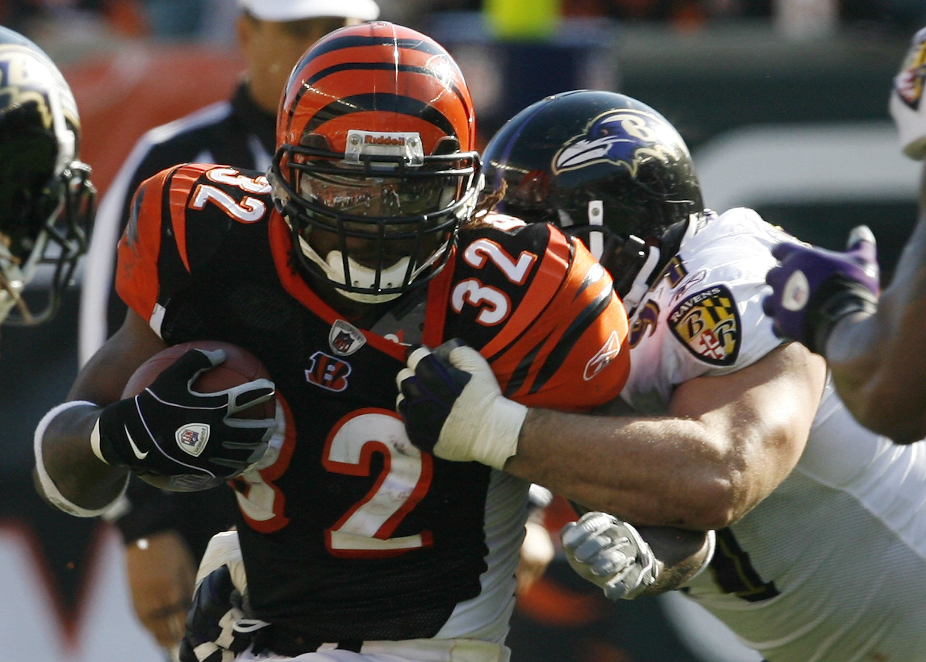 CINCINNATI - NOVEMBER 8: Cedric Benson #32 of the Cincinnati Bengals is tackled by Kelly Gregg #97 of the Baltimore Ravens at Paul Brown Stadium on November 8, 2009 in Cincinnati, Ohio.  (Photo by John Sommers II/Getty Images)
