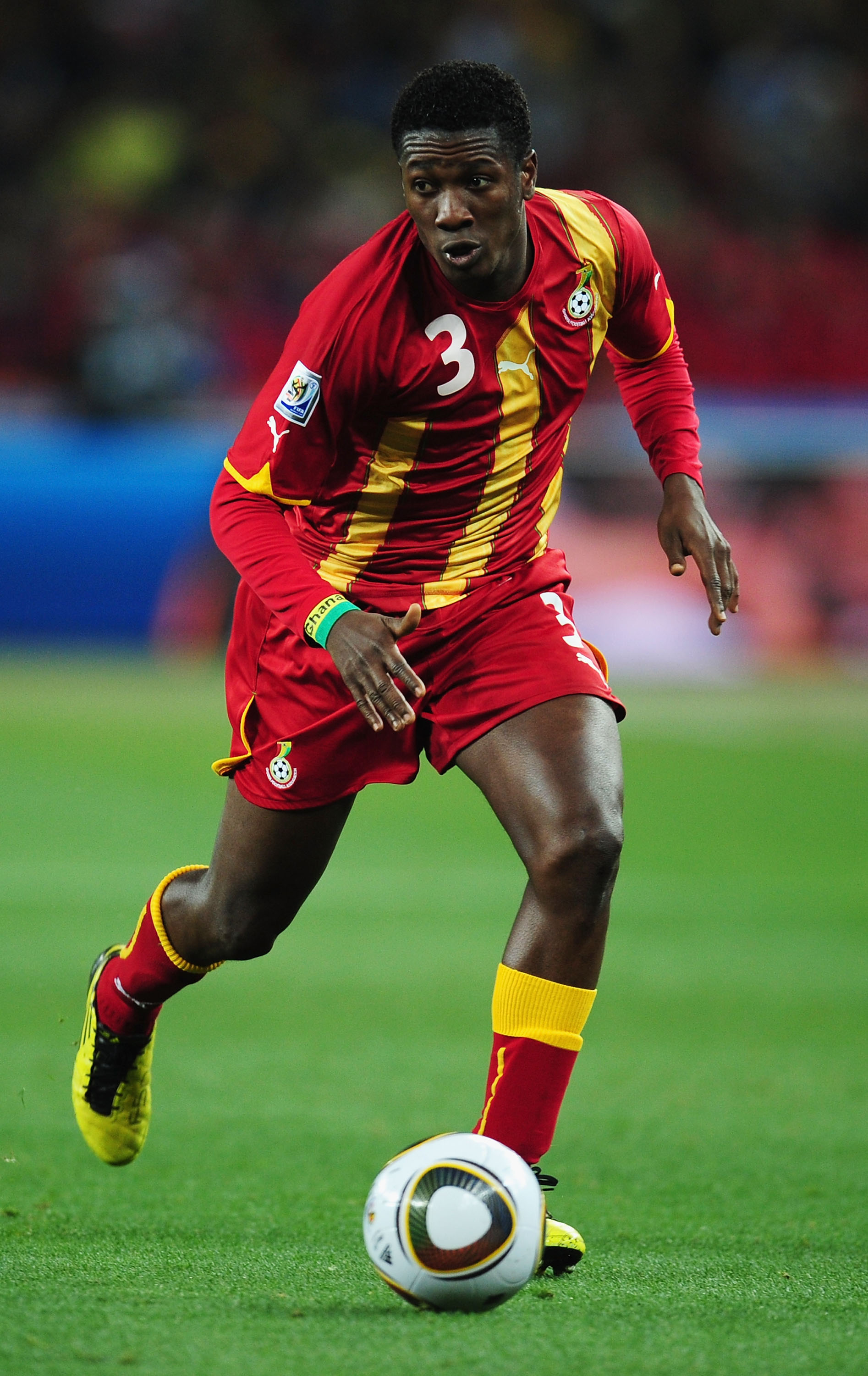 JOHANNESBURG, SOUTH AFRICA - JULY 02:  Asamoah Gyan of Ghana runs with the ball during the 2010 FIFA World Cup South Africa Quarter Final match between Uruguay and Ghana at the Soccer City stadium on July 2, 2010 in Johannesburg, South Africa.  (Photo by