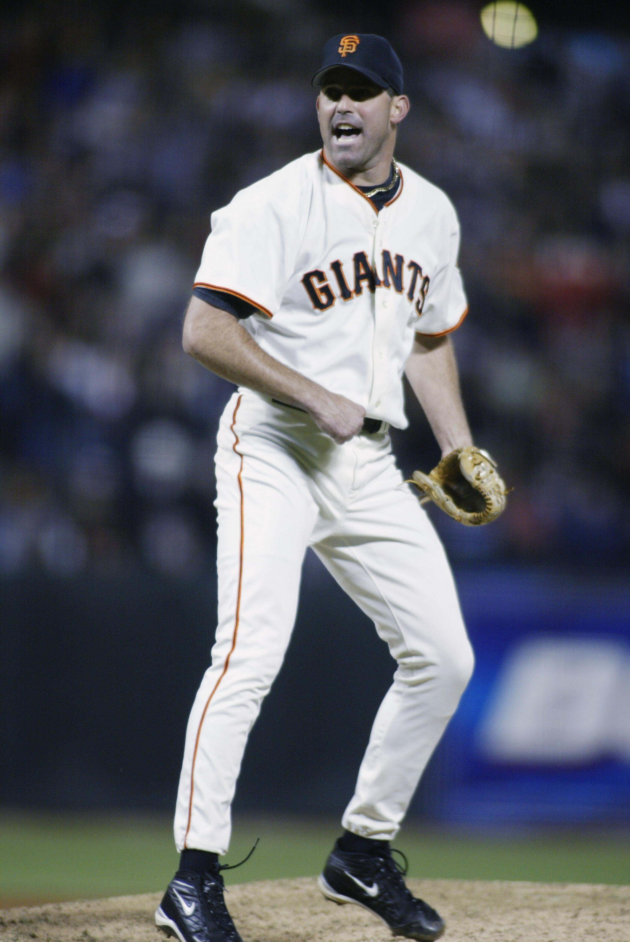 SAN FRANCISCO - SEPTEMBER 27:  Closing pitcher Rob Nen #31 of the San Francisco Giants celebrates after beating the Houston Astros in the game on September 27, 2002 at Pac Bell Park in San Francisco, California.  The Giants defeated the Astros 2-1.  (Phot