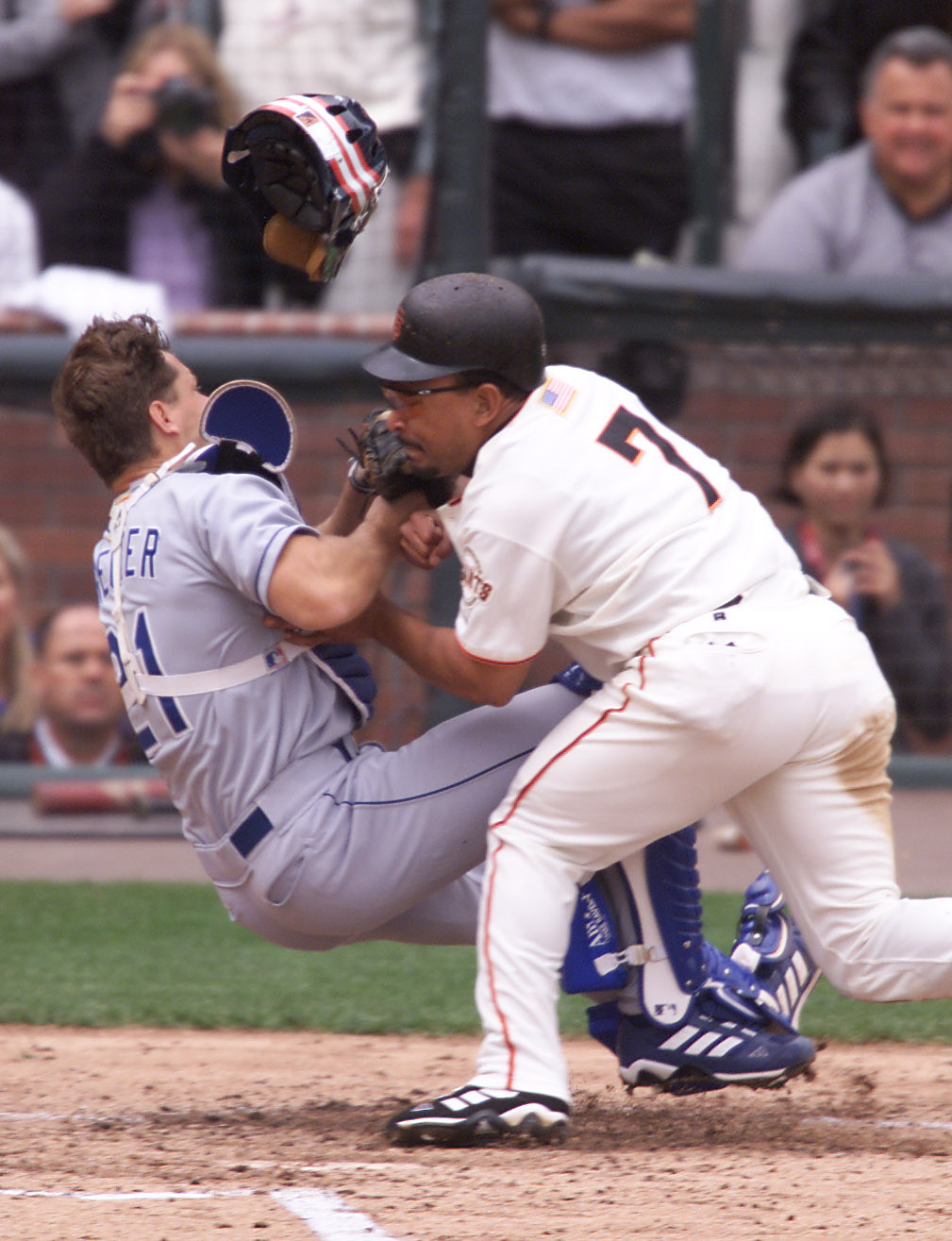 7 Oct 2001:  Marvin Benard of the San Francisco Giants collides with catcher Chad Kreuter of the Los Angeles Dodgers on a single hit by Barry Bonds at Pac Bell Park in San Francisco, California. Bernard was out on the play. DIGITAL IMAGE Mandatory Credit: